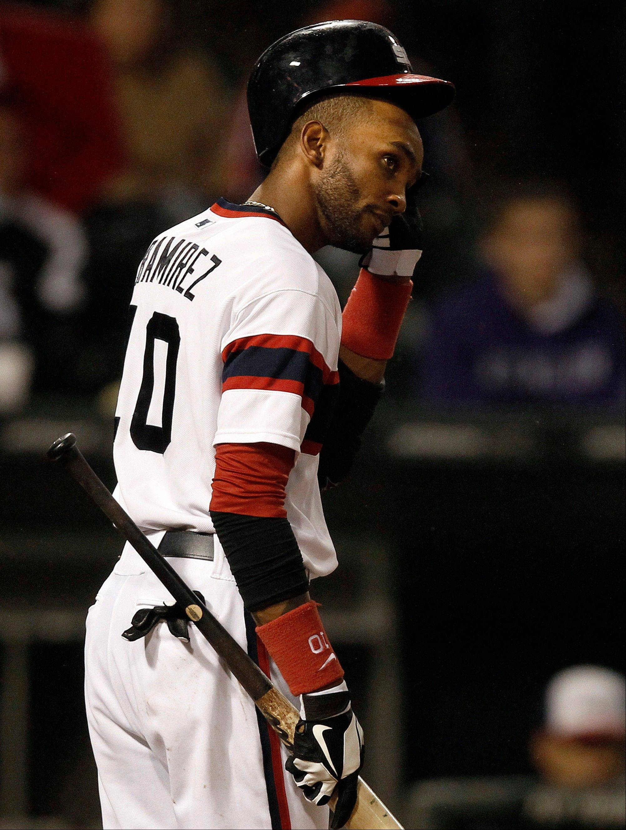 The White Sox's Alexei Ramirez removes his helmet after striking out swinging during the sixth inning of a baseball game against the Cleveland Indians, Sunday, Sept. 15, 2013, in Chicago.