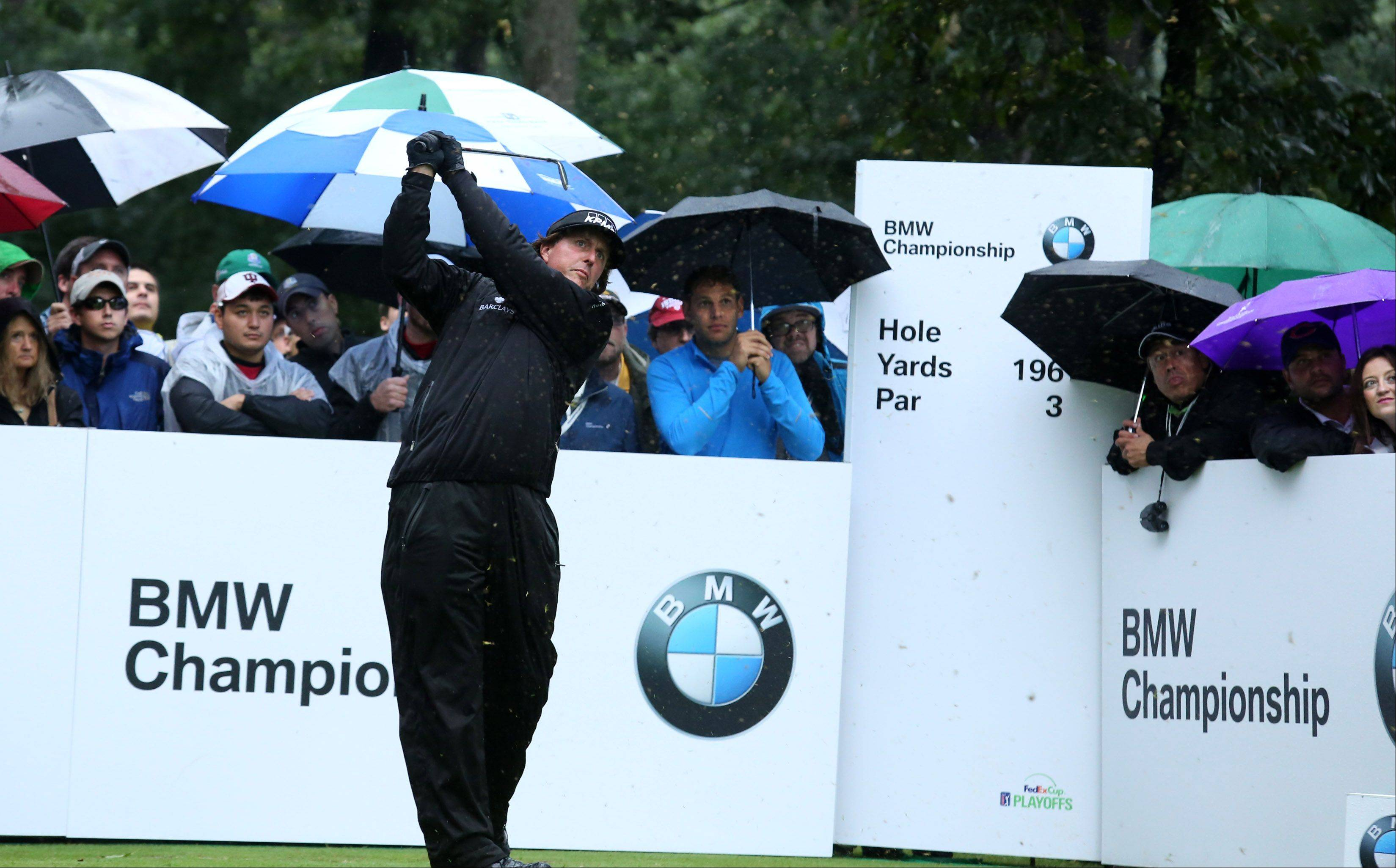Phil Mickelson tees off on the second hole during the final round of the BMW Championship at Conway Farms Golf Club in Lake Forest on Sunday. Play was suspended until 8 a.m. Monday.