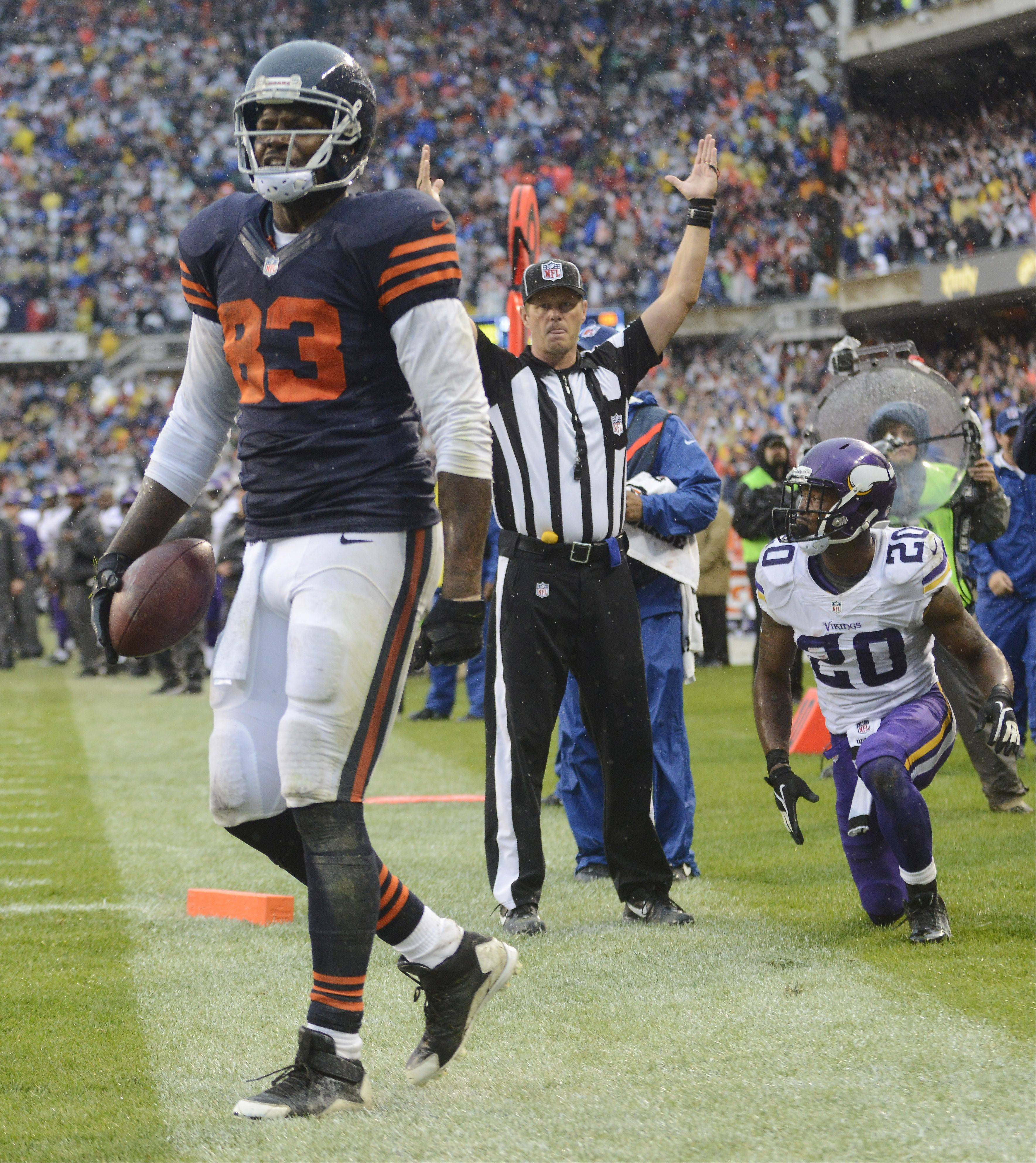 Bears tight end Martellus Bennett celebrates his touchdown catch in front of Minnesota Vikings cornerback Chris Cook with 10 seconds left Sunday at Soldier Field.