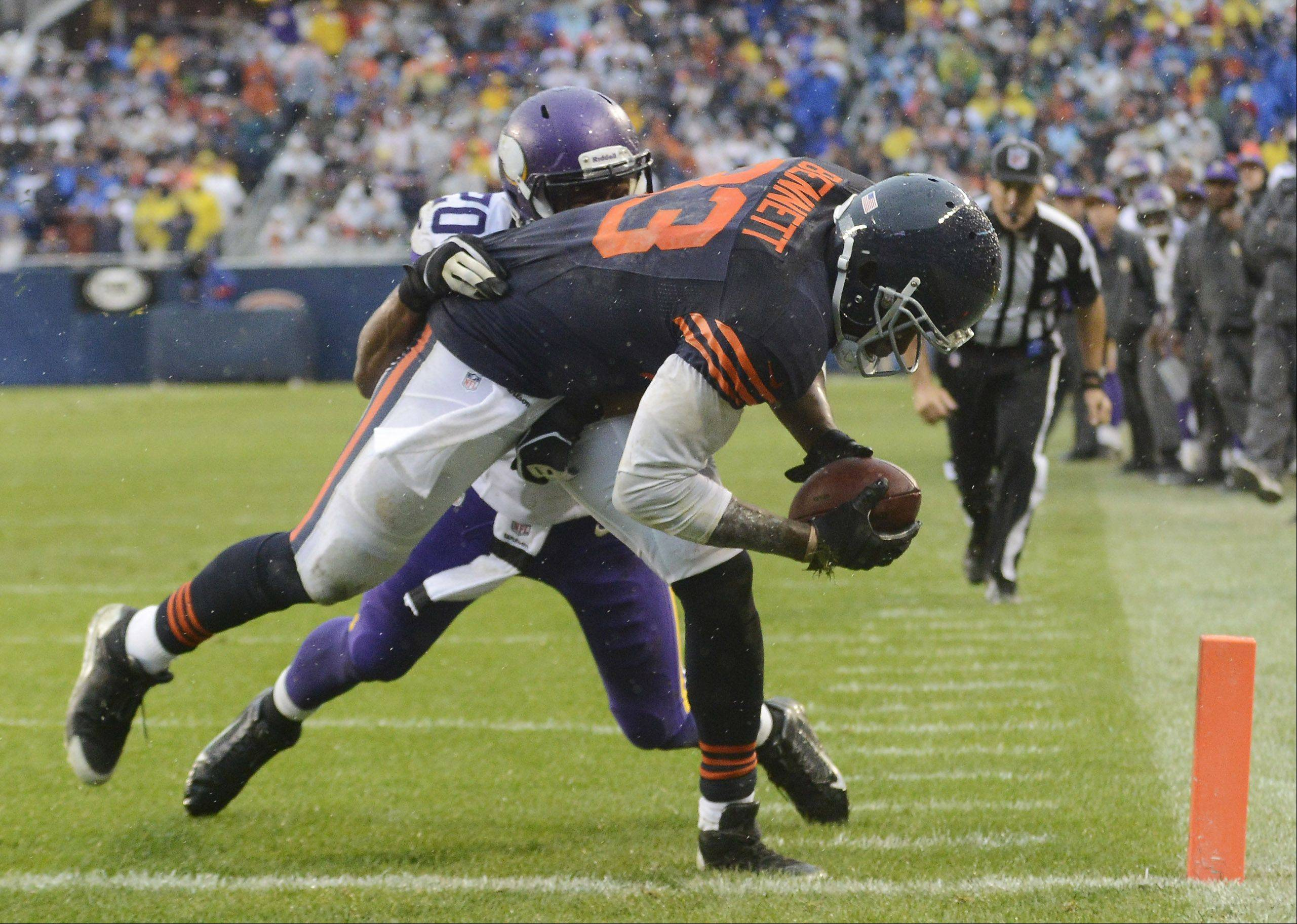 Chicago Bears tight end Martellus Bennett makes a touchdown catch in front of Minnesota Vikings cornerback Chris Cook with 10 seconds left during Sunday's game at Soldier Field.