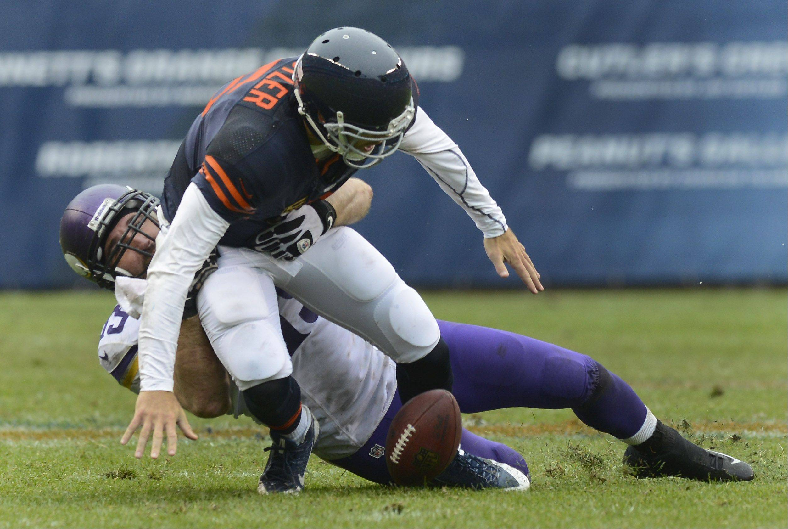 Chicago Bears quarterback Jay Cutler fumbles after being tackled by Minnesota Vikings defensive end Jared Allen during the second quarter of Sunday's game at Soldier Field. Minnesota returned the fumble for a touchdown.