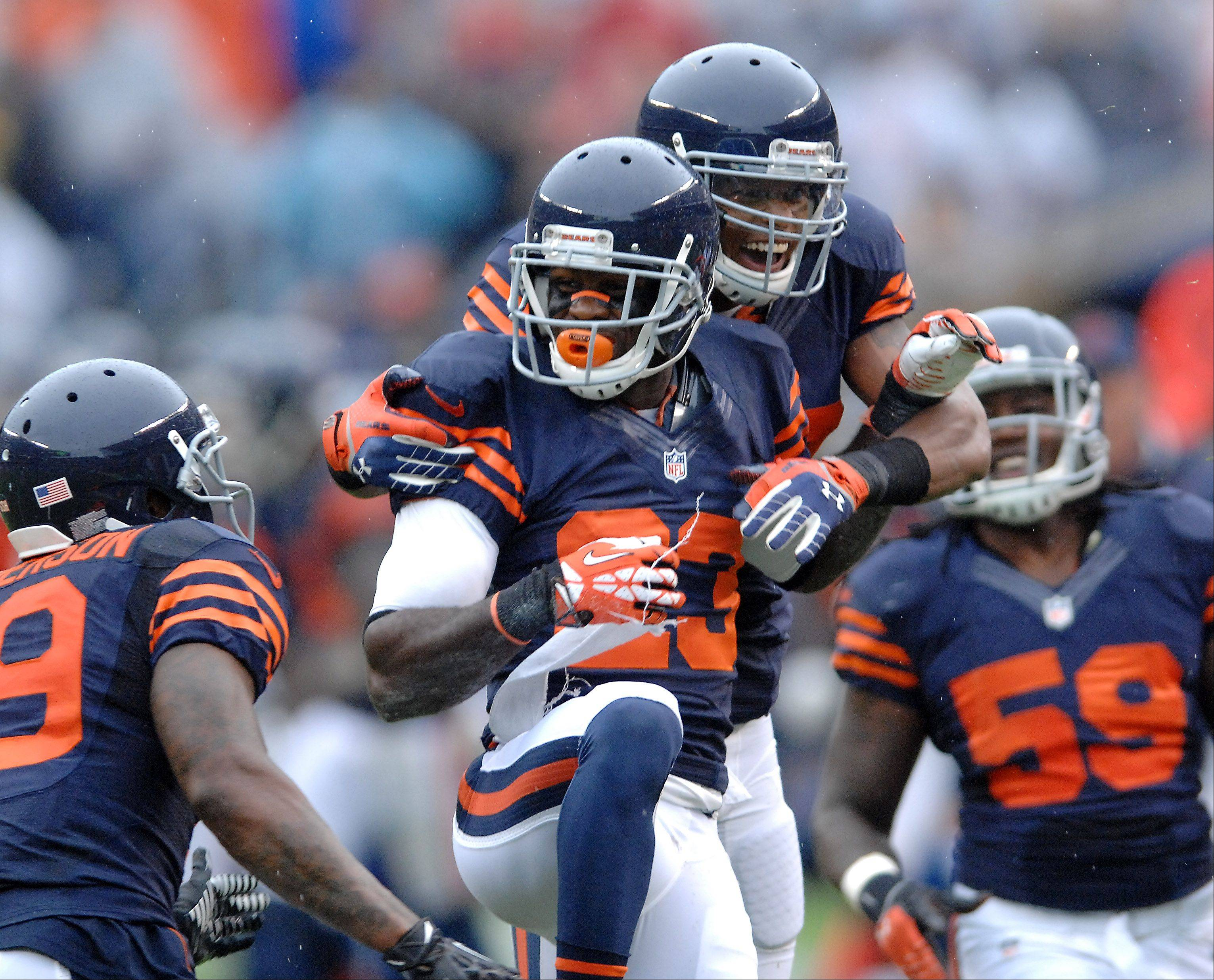 Bears teammates pile on Devin Hester after he nearly scored on a kick return in the second quarter during Sunday's game at Soldier Field in Chicago.