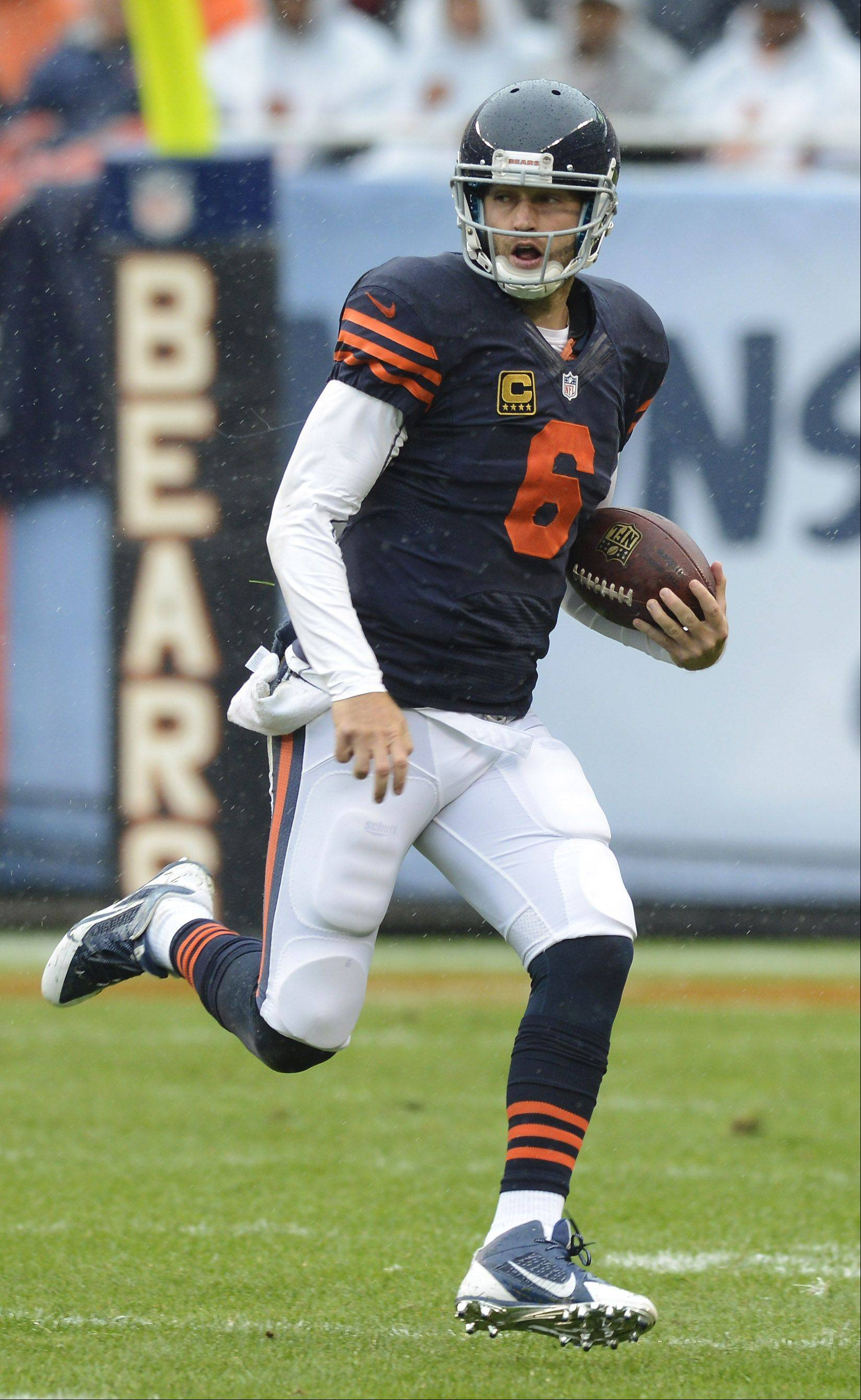 Chicago Bears quarterback Jay Cutler carries the ball during Sunday's game against the Minnesota Vikings at Soldier Field.