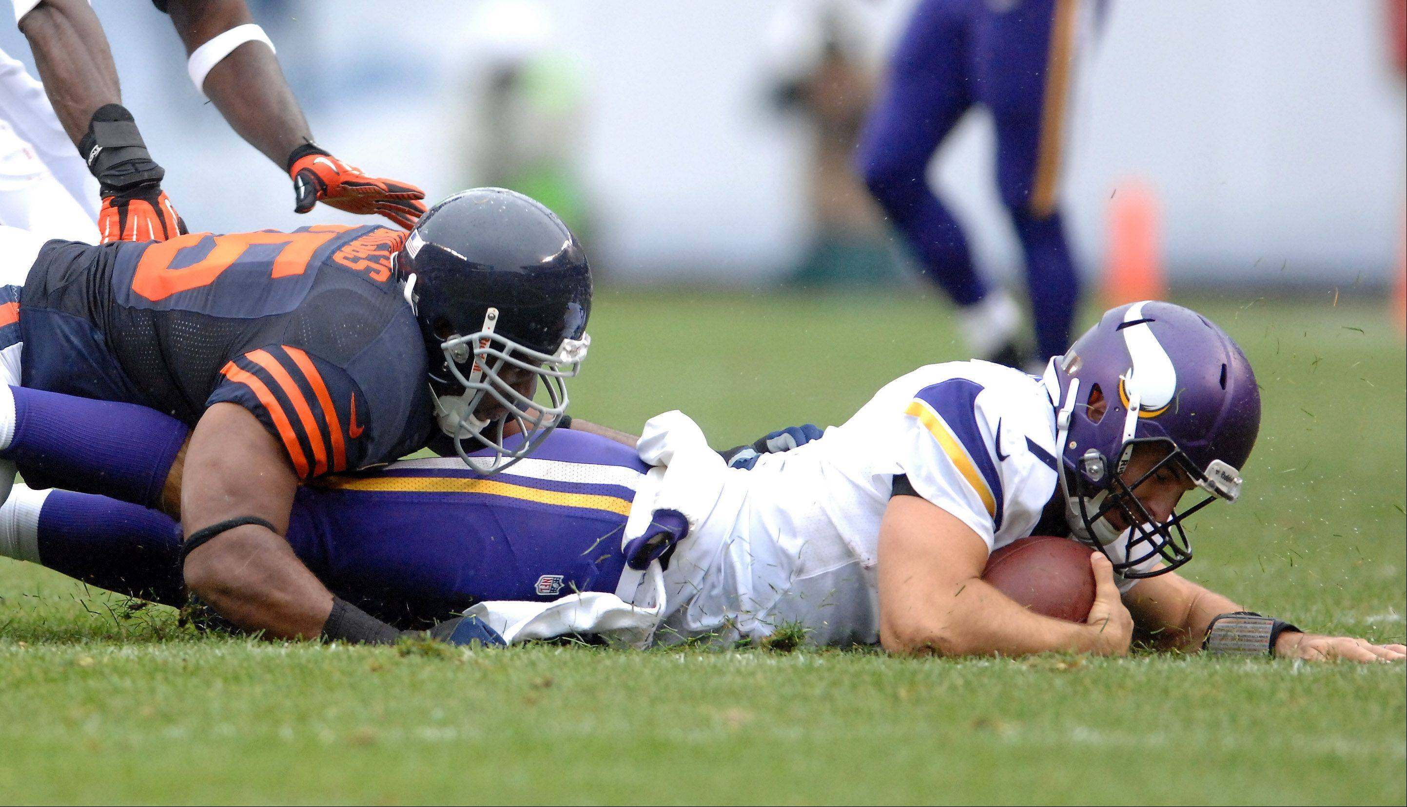 Chicago Bears outside linebacker Lance Briggs (55) brings down Minnesota Vikings quarterback Christian Ponder (7) during Sunday's game at Soldier Field in Chicago.