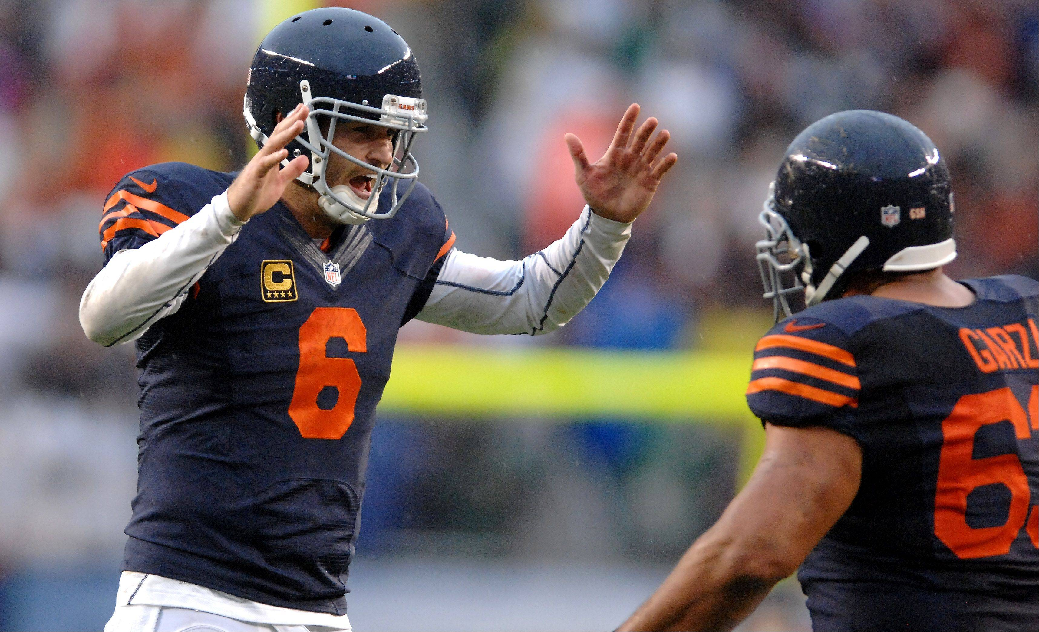 Chicago Bears quarterback Jay Cutler (6) celebrates the game-winning touchdown with center Roberto Garza (63) during Sunday's game at Soldier Field in Chicago.