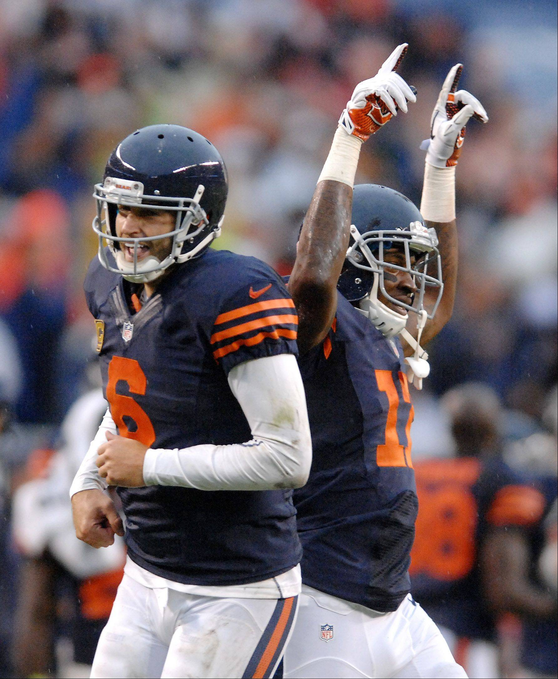 Chicago Bears quarterback Jay Cutler (6) and wide receiver Alshon Jeffery (17) celebrate after the extra point puts the Bears ahead with 10 seconds left during Sunday's game at Soldier Field in Chicago.