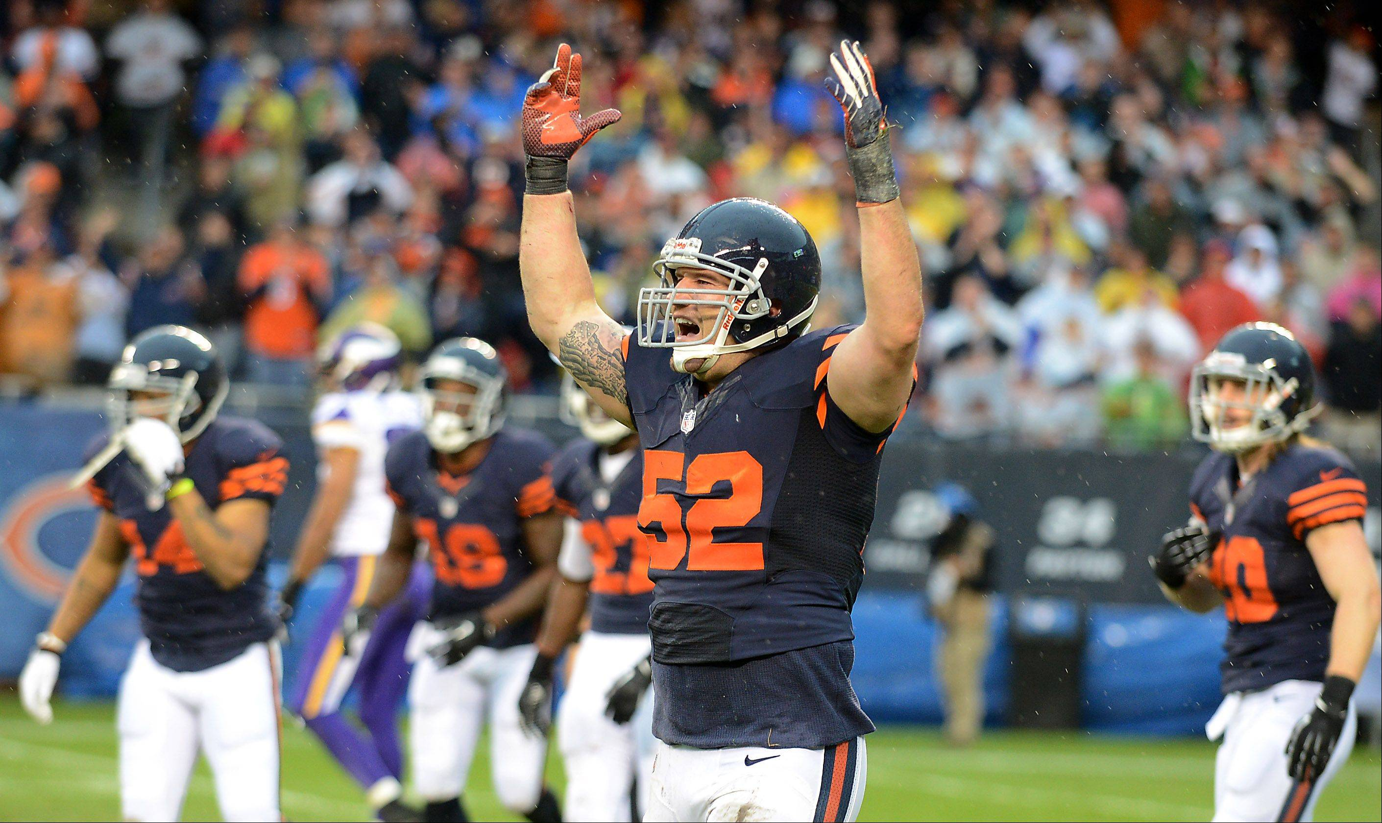 Blake Costanzo (52) and the Bears special teams celebrate after taking ball away from Minnesota on the final kickoff during Sunday's game at Soldier Field in Chicago.