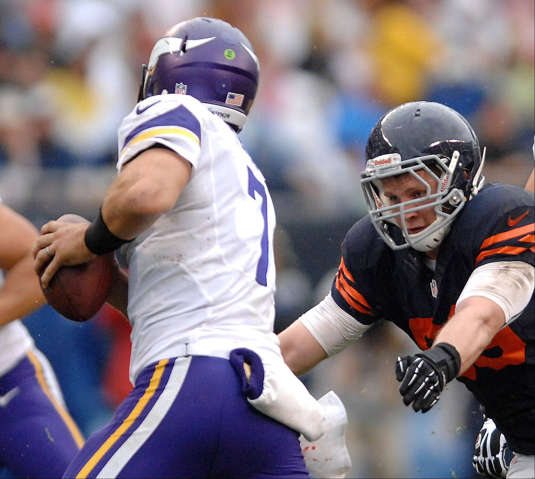 Chicago Bears defensive end Shea McClellin (99) pressures Minnesota Vikings quarterback Christian Ponder (7) during Sunday's game at Soldier Field in Chicago.