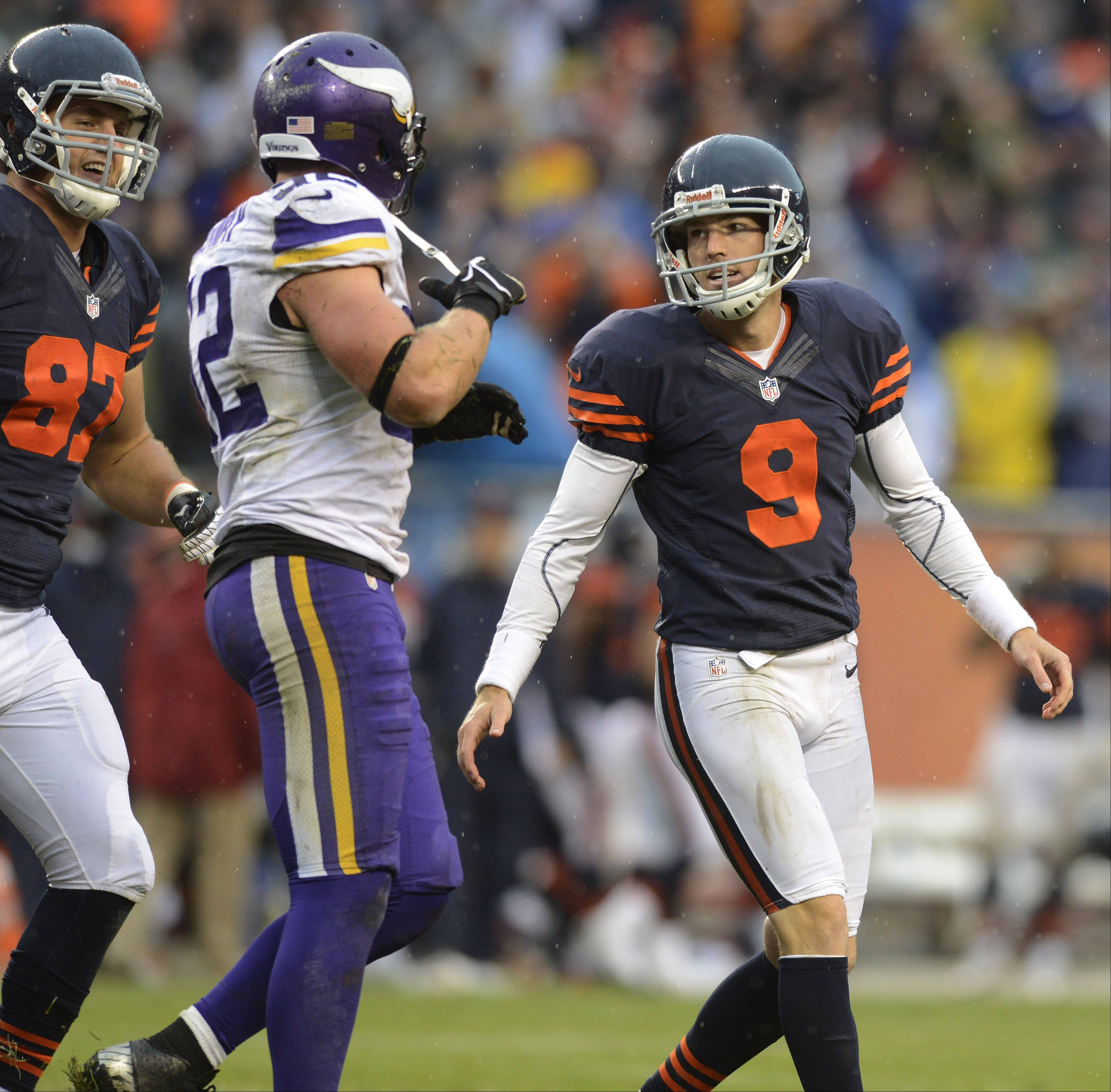 Chicago Bears kicker Robbie Gould, right, smiles with teammate Steve Maneri after kicking the extra-point that put the team ahead of the Vikings during Sunday's game at Soldier Field. The Vikings' Chad Greenway is between the two Bears players.