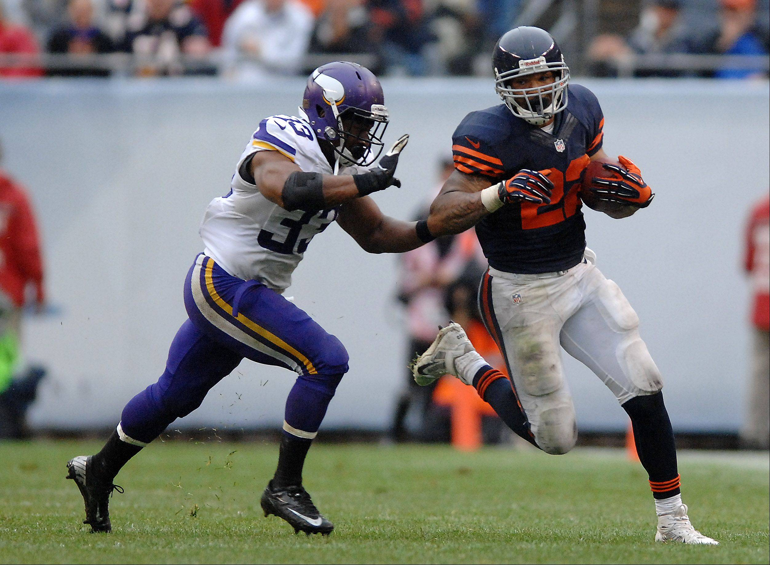 Chicago Bears running back Matt Forte (22) picks up some yards after the catch with Minnesota Vikings strong safety Jamarca Sanford (33) giving chase during Sunday's game at Soldier Field in Chicago.