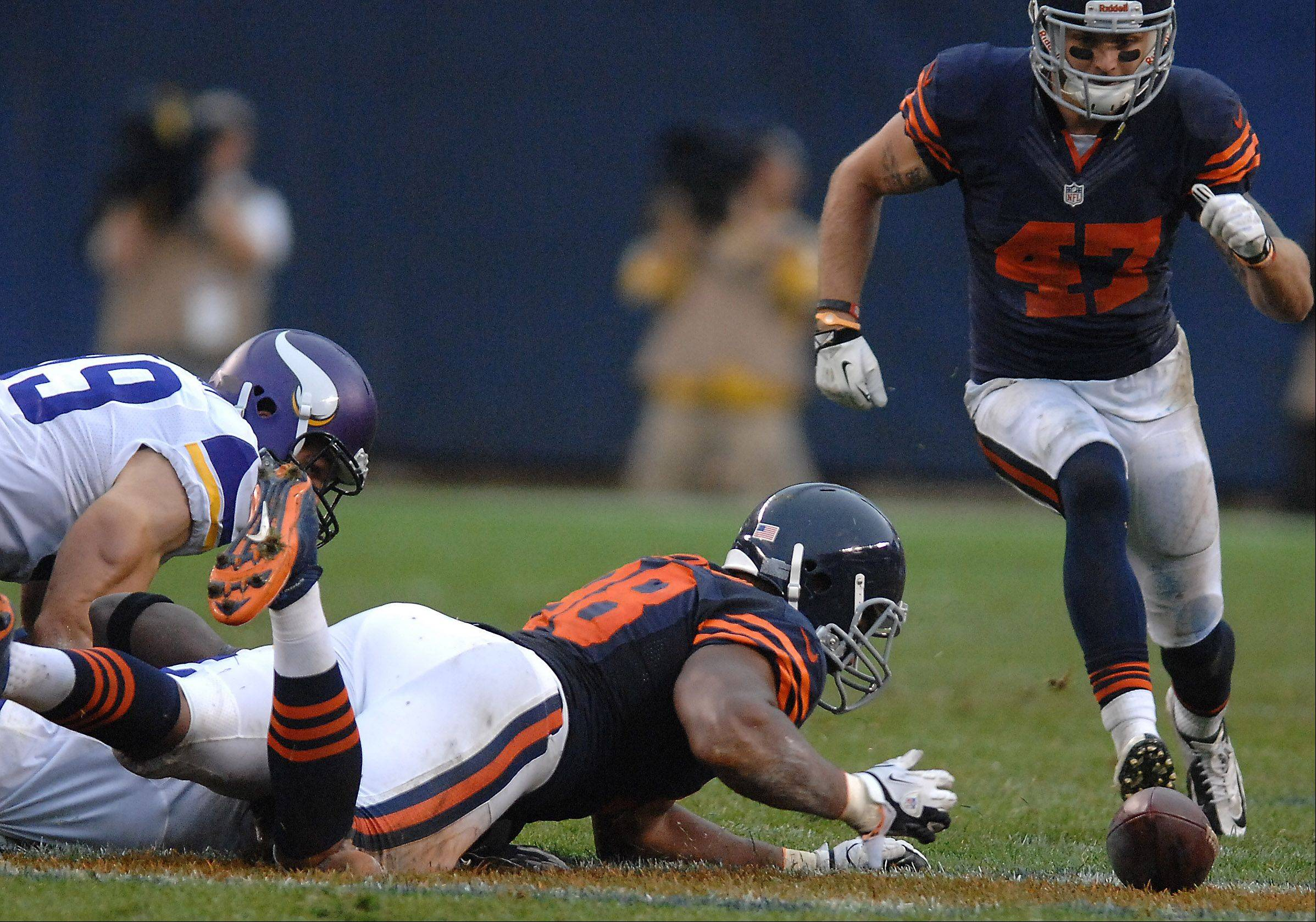 Chicago Bears defensive end Corey Wootton (98) reaches out to grab a fumble during Sunday's game at Soldier Field in Chicago.
