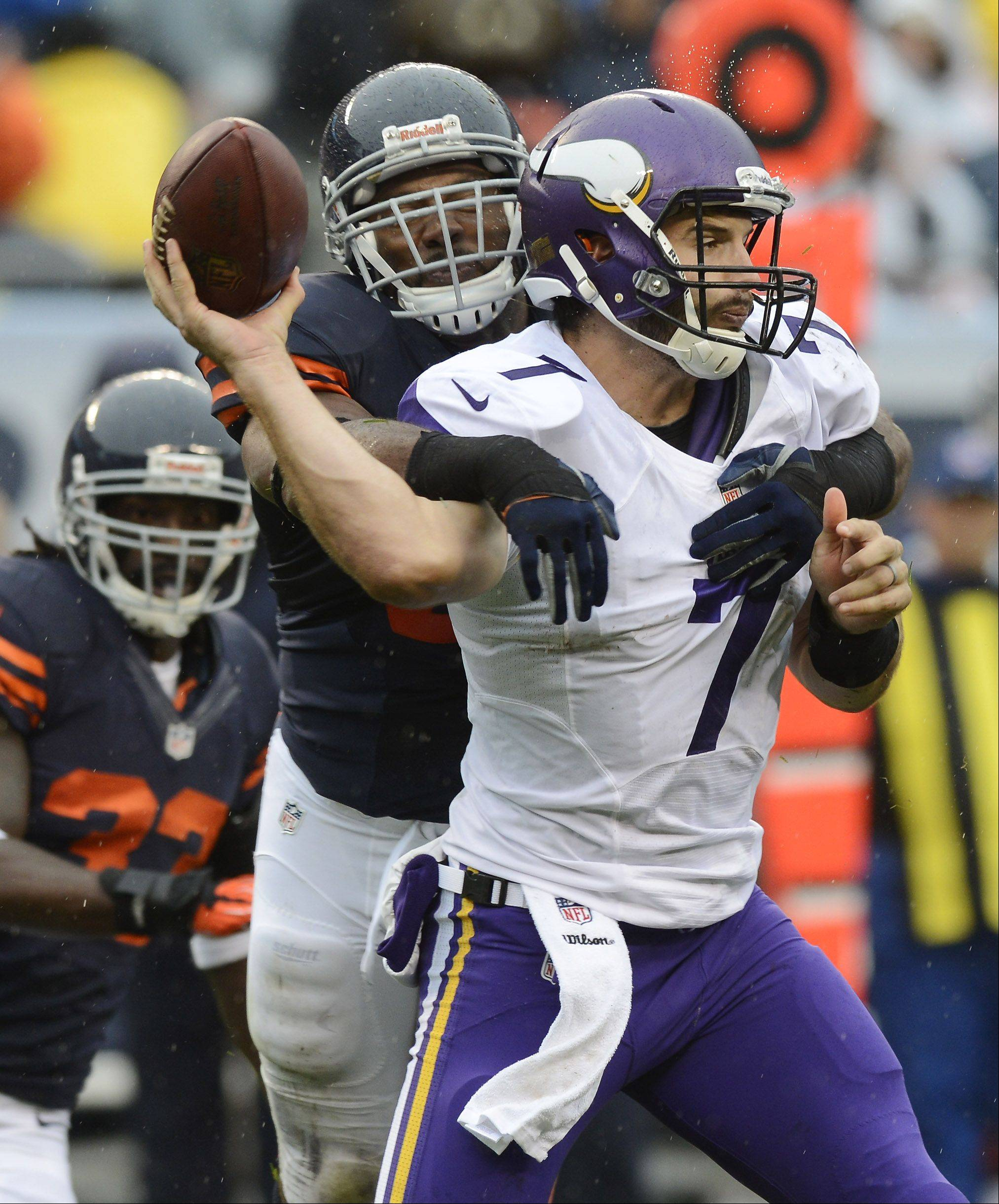 Chicago Bears outside linebacker Lance Briggs pressures Minnesota Vikings quarterback Christian Ponder during Sunday's game at Soldier Field.