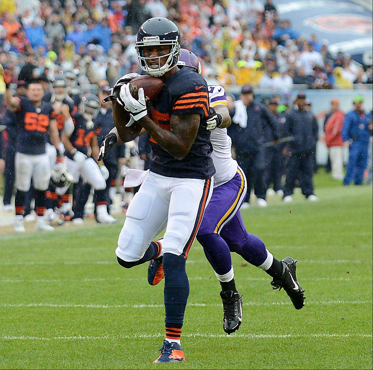 Chicago Bears wide receiver Brandon Marshall (15) hauls in a first-quarter touchdown pass during Sunday's game at Soldier Field in Chicago.
