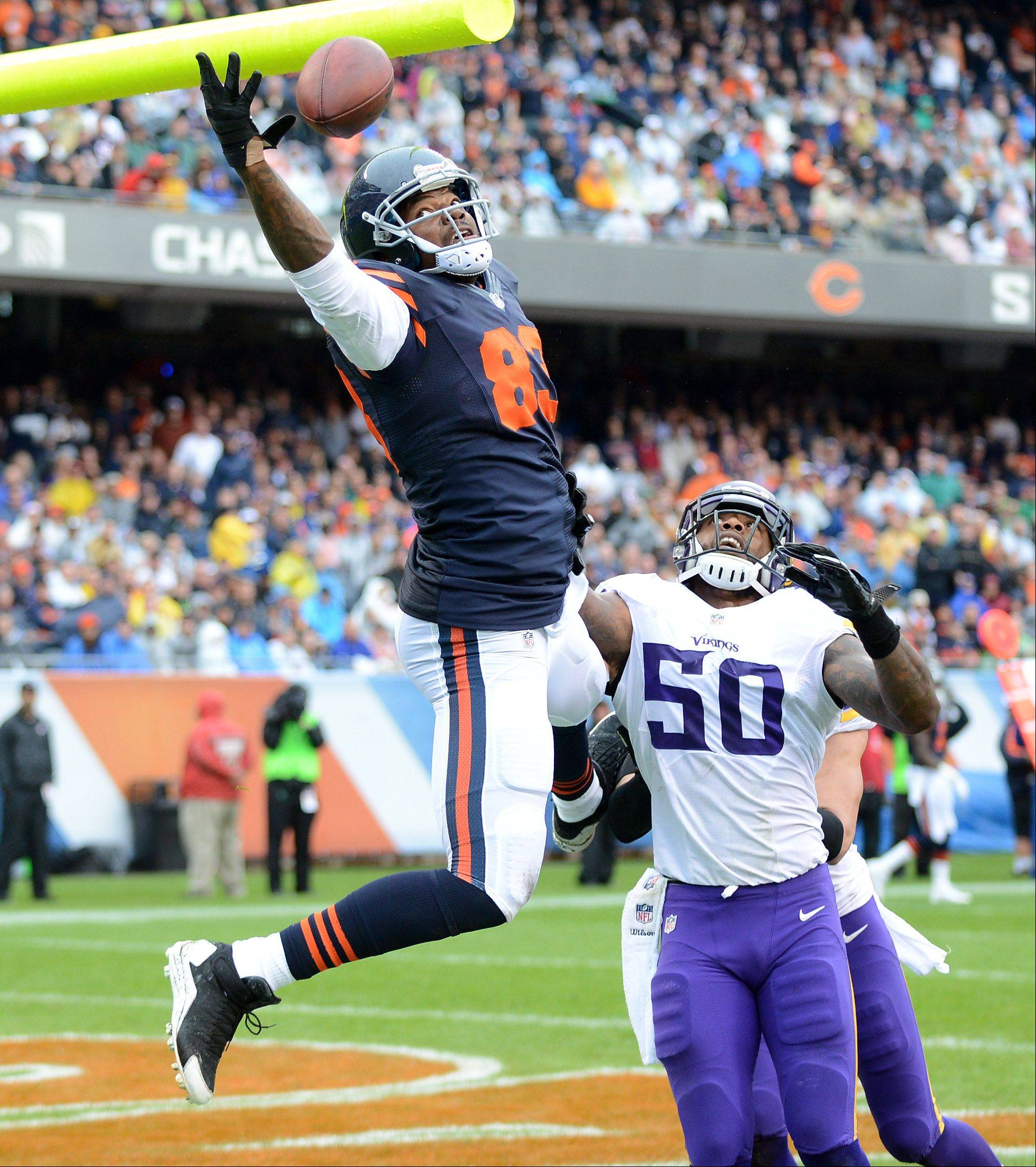 Chicago Bears tight end Martellus Bennett (83) stretches but can't come up with a catch in the end zone during Sunday's game at Soldier Field in Chicago.