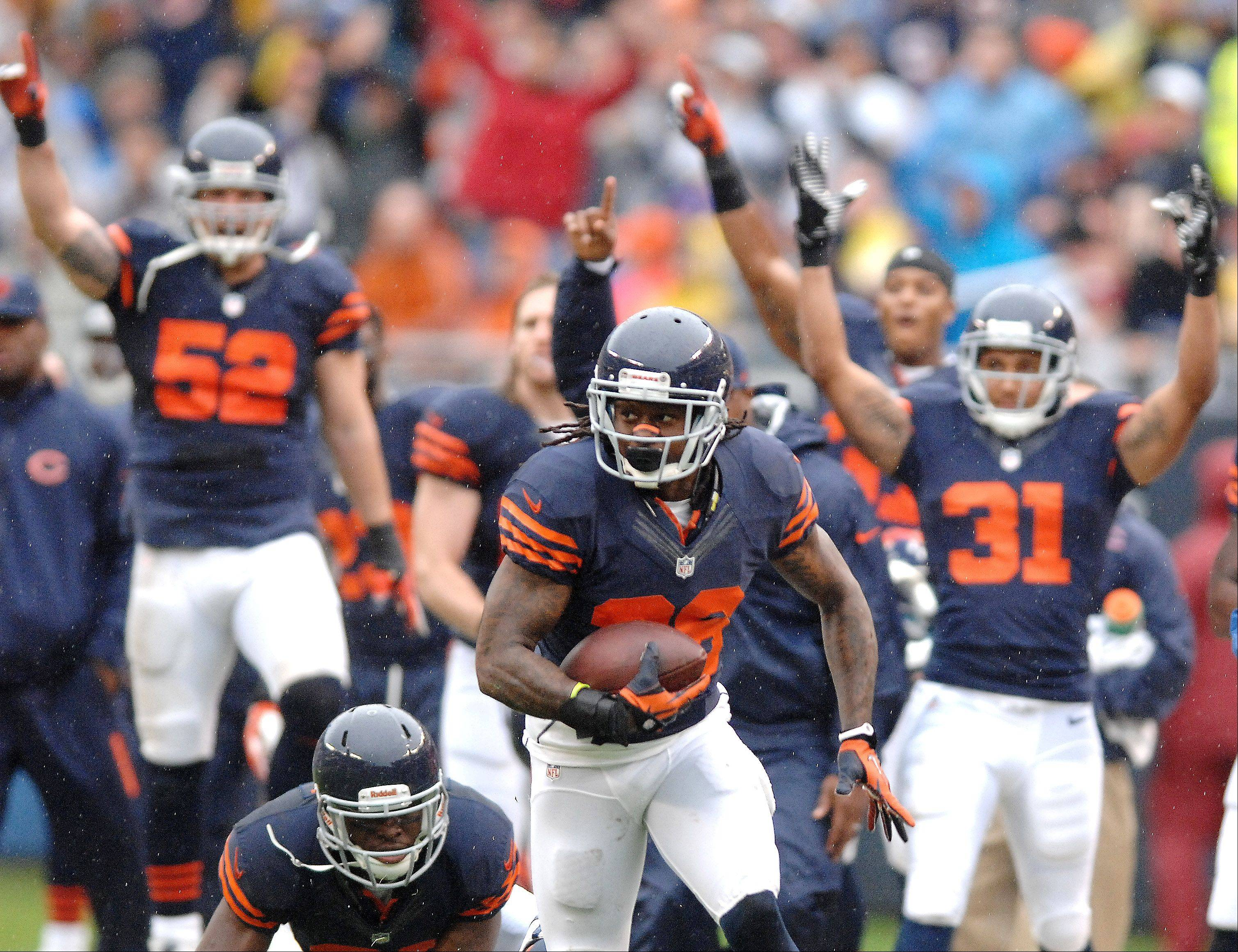 Chicago Bears cornerback Tim Jennings (26) returns an interception for a touchdown during Sunday's game at Soldier Field in Chicago.