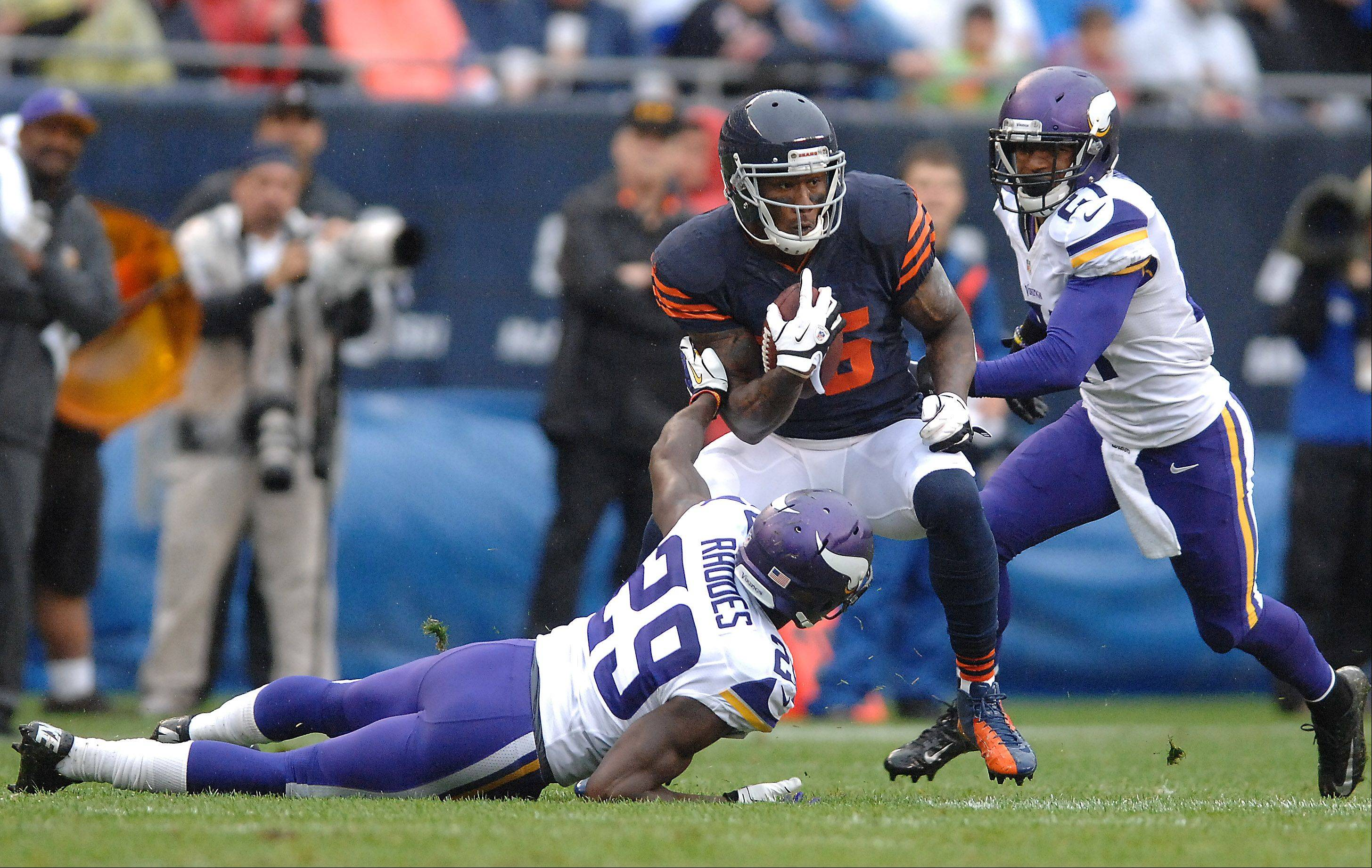 Chicago Bears wide receiver Brandon Marshall (15) puts a move on Minnesota Vikings cornerback Xavier Rhodes (29) to pick up some extra yards during Sunday's game at Soldier Field in Chicago.