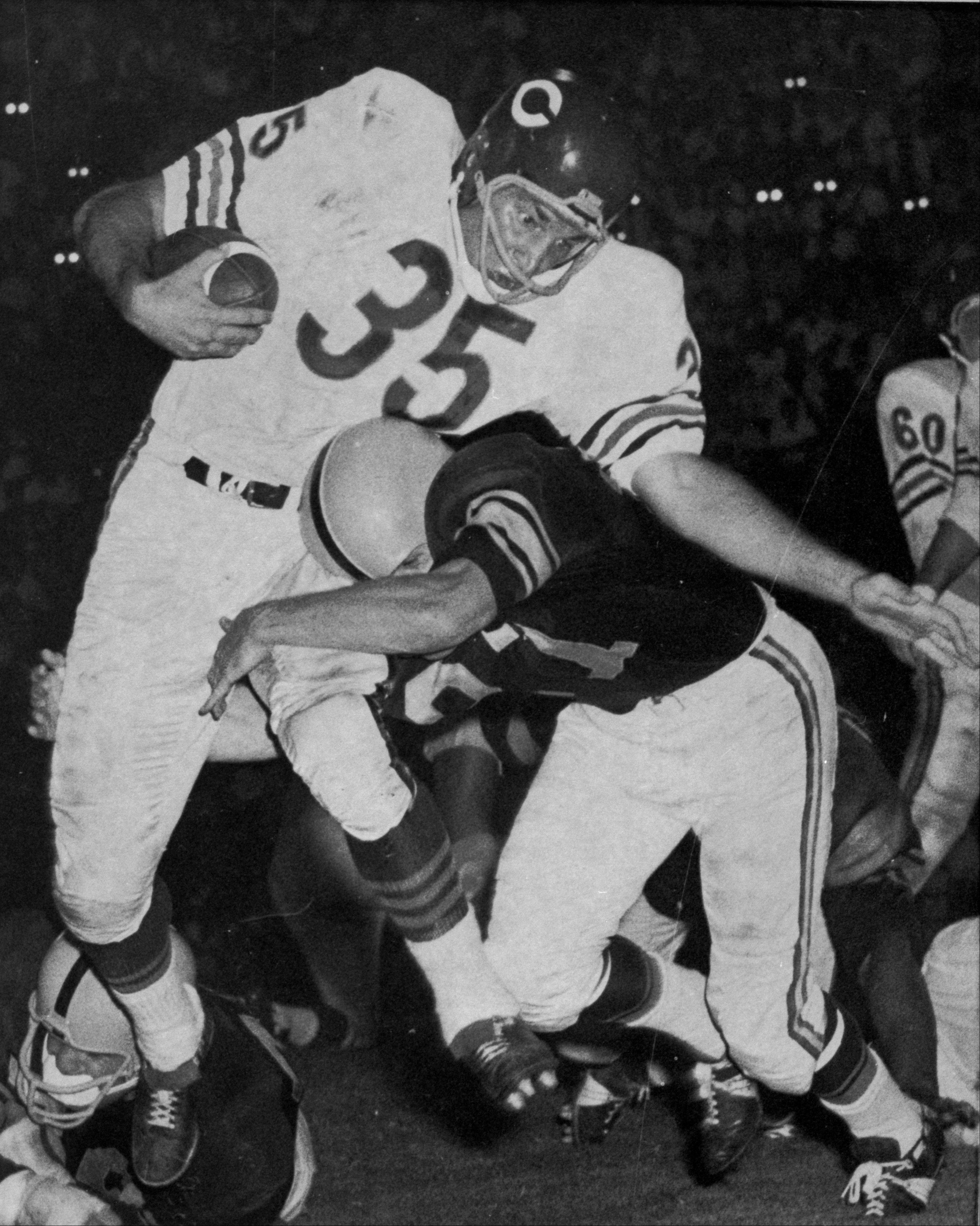 In this Aug. 11, 1962, file photo, Chicago Bears' Rick Casares is hit by a Pittsburgh Steelers player during an exhibition NFL football game in Atlanta. Casares, a star running back for the Bears who was once their all-time leading rusher, died at his home in Tampa, Fla., on Friday, Sept. 13, the Bears announced Sunday, Sept. 15, 2013. He was 82.