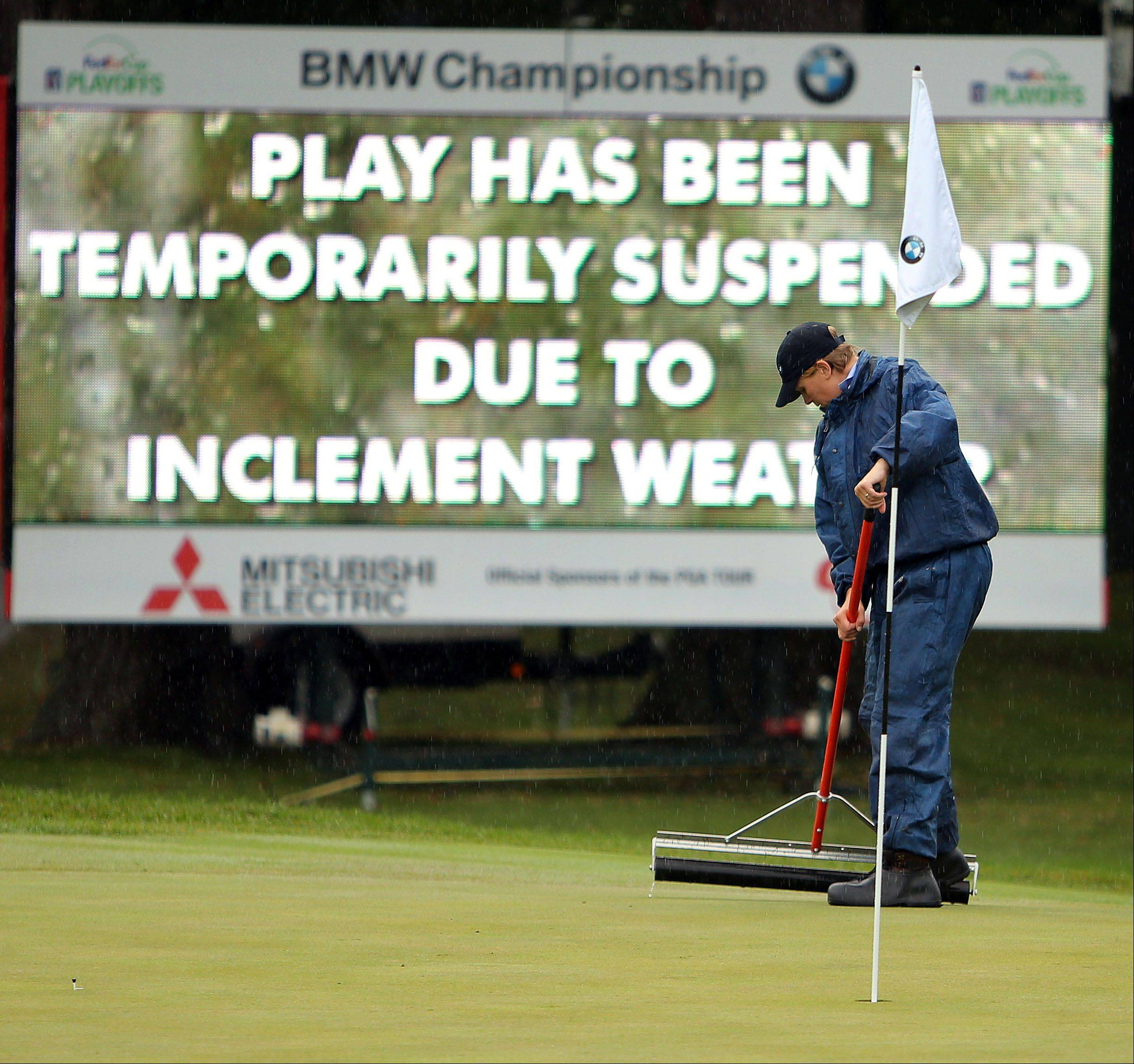 Steady rain suspended play during the final round of the BMW Championship at Conway Farms Golf Club in Lake Forest Sunday. The tournament will restart at 8 a.m. Monday.