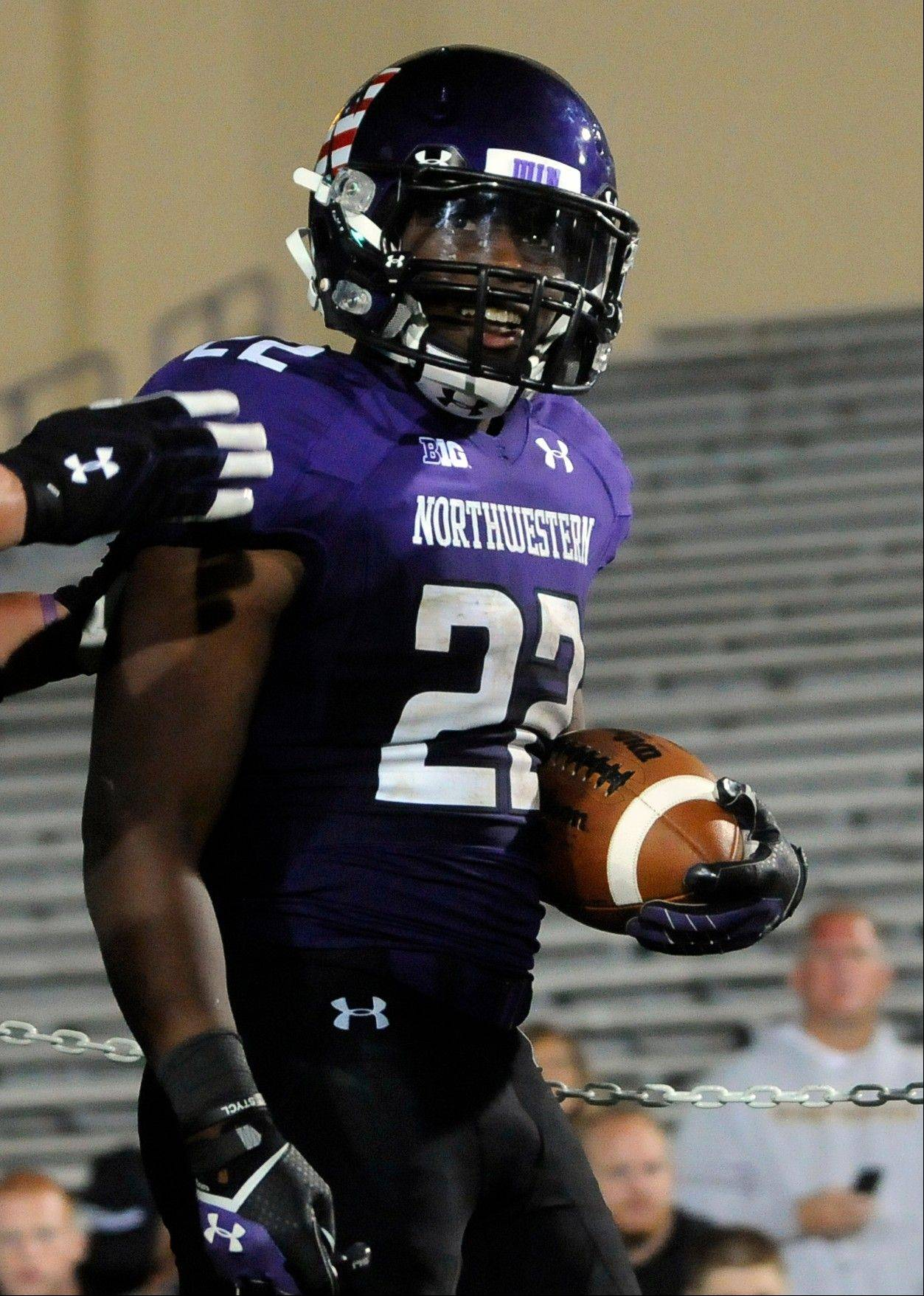 Northwestern's Treyvon Green (22) celebrates his touchdown against Western Michigan during the fourth quarter of an NCAA college football game in Evanston, Ill., Saturday, Sept. 14, 2013.