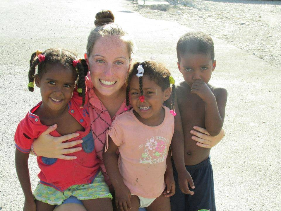 Prospect High School senior, Alexandra Wilson, with 3 children from Las Minas, Dominican Republic.