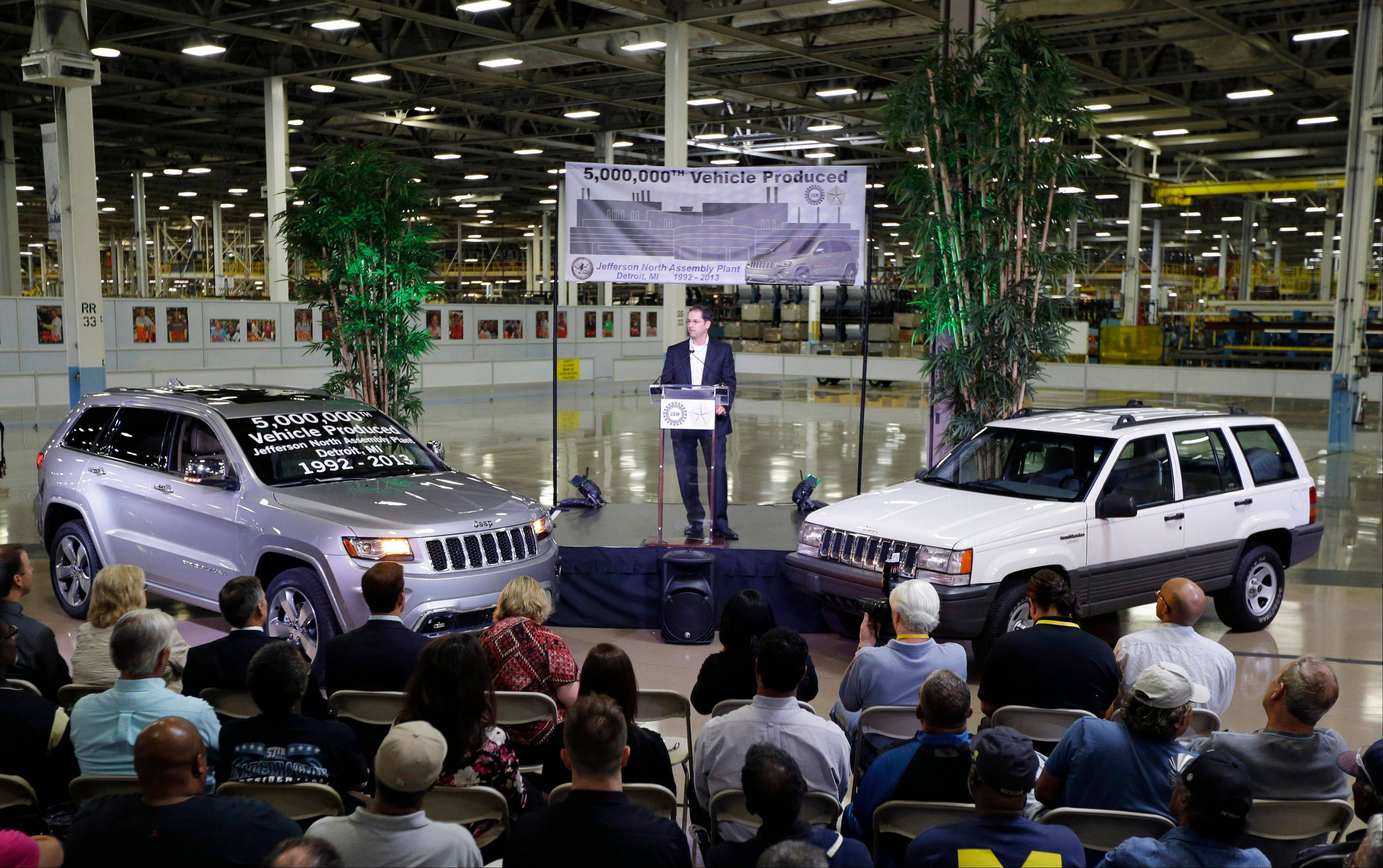 Scott Garberding, senior vice president of manufacturing for Chrysler Group LLC stands between a 1992 Grand Cherokee, right, and the automaker�s 5,000,000th vehicle produced at the Jefferson North Assembly Plant, in Detroit. U.S. factories increased output in August by the most in eight months, helped by a robust month at auto plants. The gains are a hopeful sign that manufacturing could help boost economic growth in the second half of the year.
