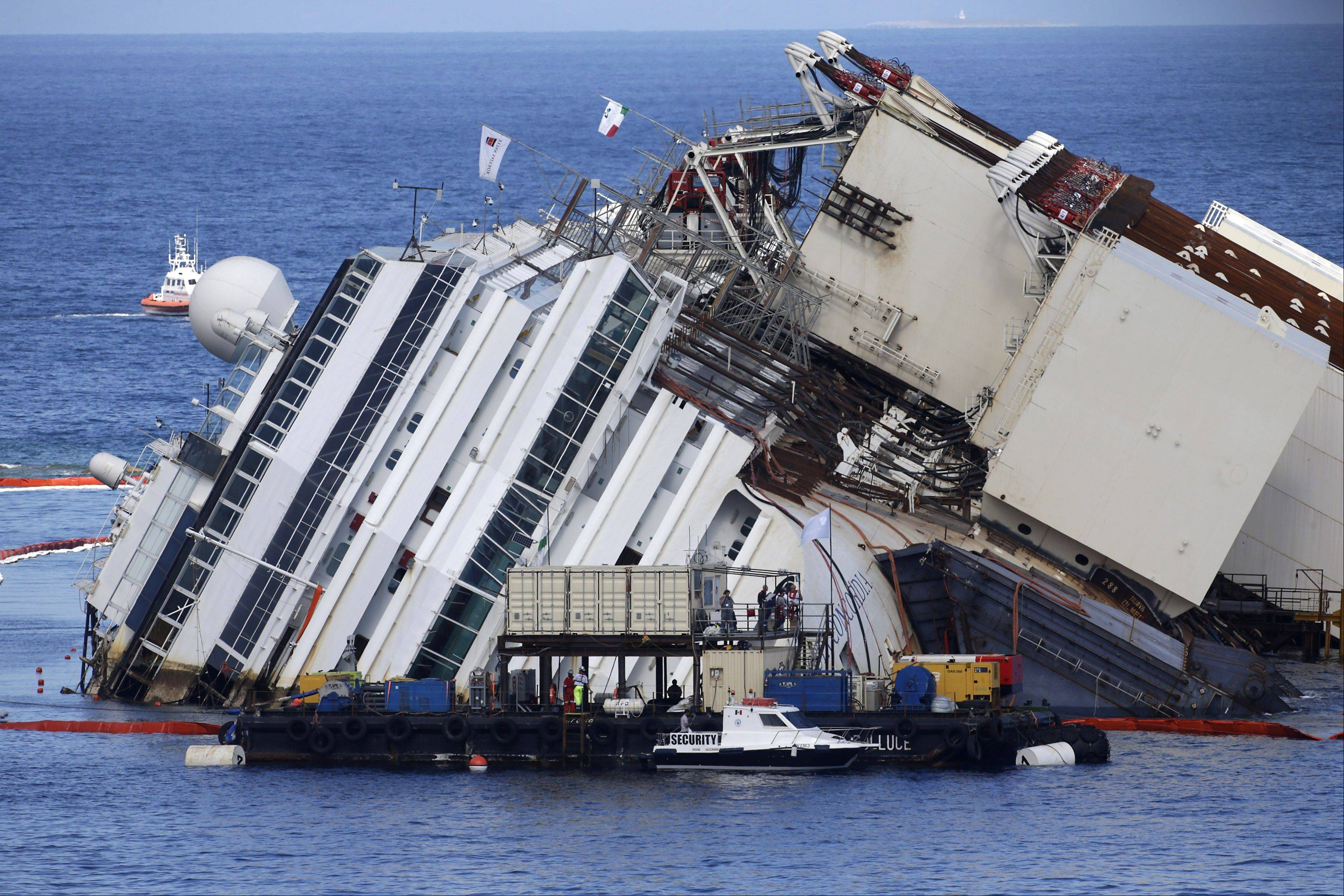 The Costa Concordia ship lies on its side on the Tuscan Island of Giglio, Italy, early Monday morning. An international team of engineers is trying a never-before attempted strategy to set upright the luxury liner, which capsized after striking a reef in 2012 killing 32 people.