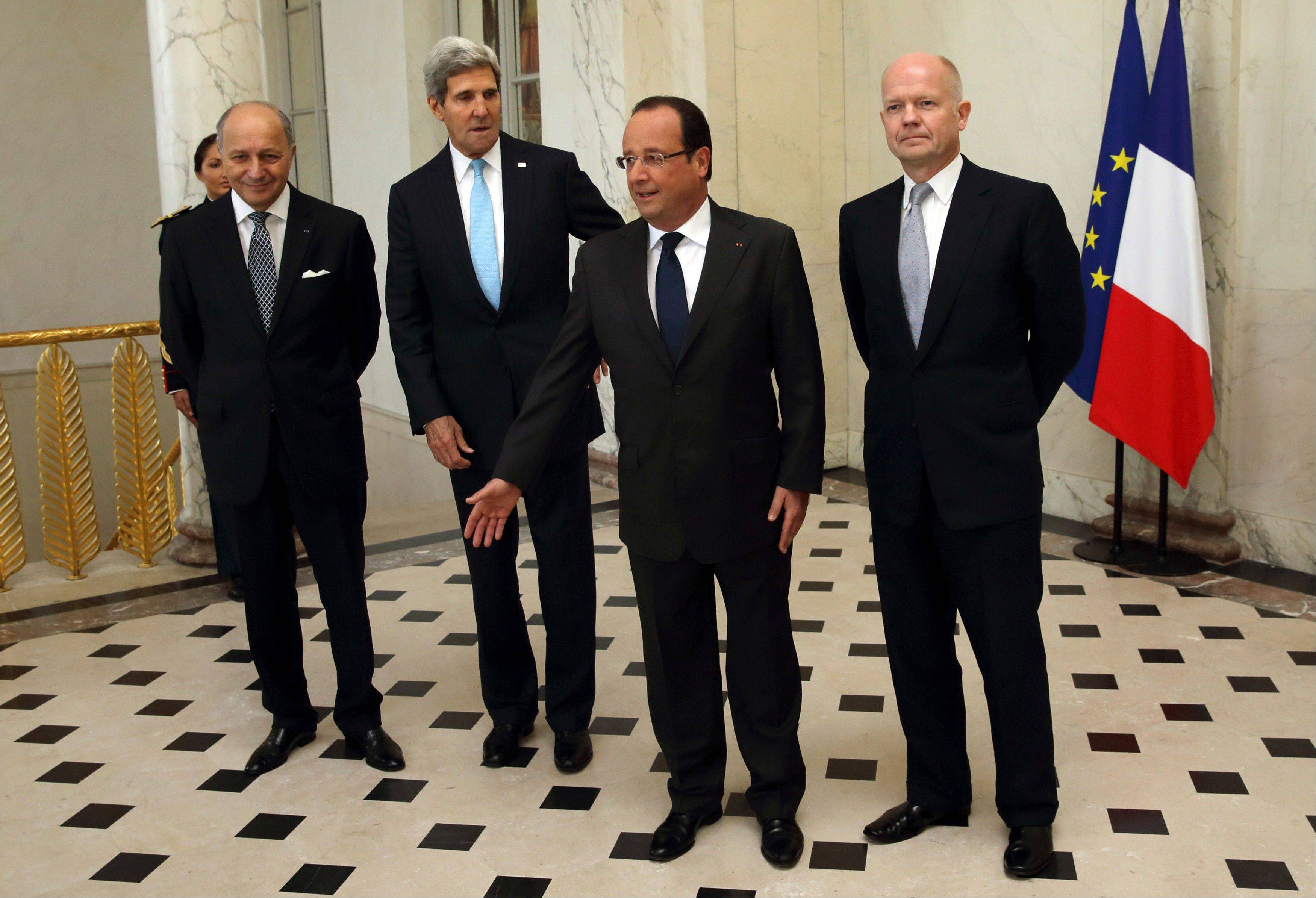 French Foreign Minister Laurent Fabius, left, U.S. Secretary of State John Kerry, French President Francois Hollande and British Foreign Secretary William Hague in the lobby of the Elysee Palace in Paris, prior to a meeting on Syria, Monday.