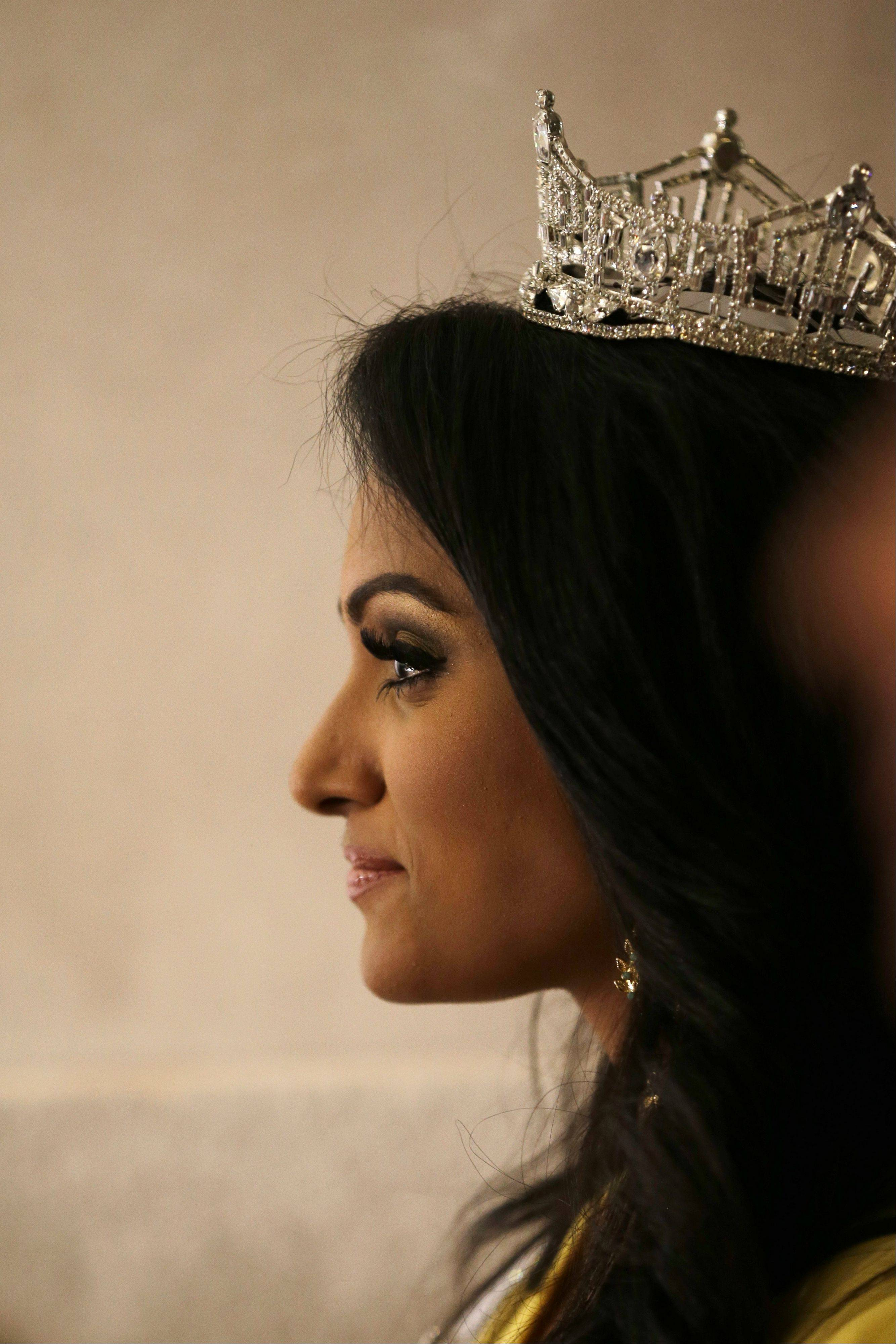 Miss New York Nina Davuluri waits to be introduced during a news conference following her crowning as Miss America 2014 on Sunday night in Atlantic City, N.J.