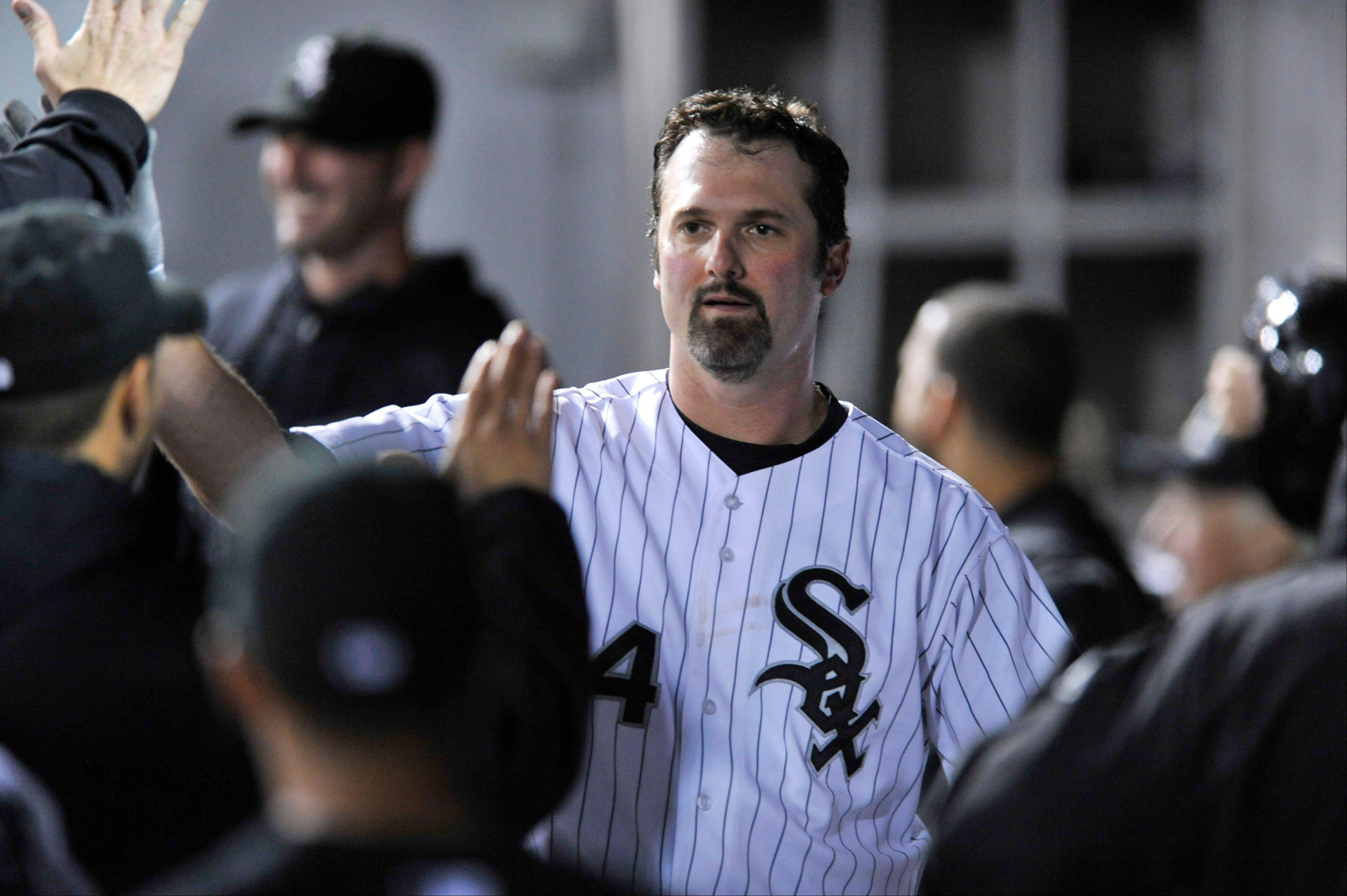 White Sox first baseman Paul Konerko celebrates with teammates in the dugout after scoring on a Gordon Beckham single during the first inning of a baseball game against the Minnesota Twins in Chicago, Monday, Sept. 16, 2013.