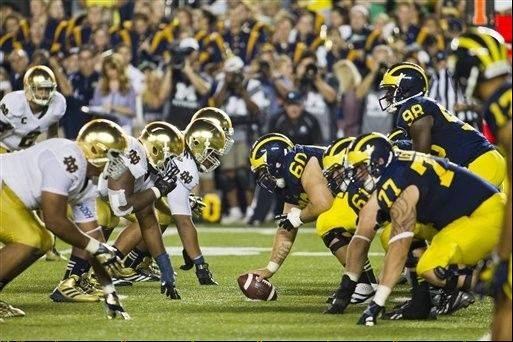 "While rivalries like Michigan and Notre Dame may stay alive, it's the idea that college athletes are not ""professionals"" that's being challenged on multiple fronts. Despite an anti-trust lawsuit from former players seeking millions of dollars in compensation, the head of the NCAA Mark Emmert, says it won't change the way things are. ""there's enormous tension right now that's growing between the collegiate model and the commercial model,"" Emmert says."