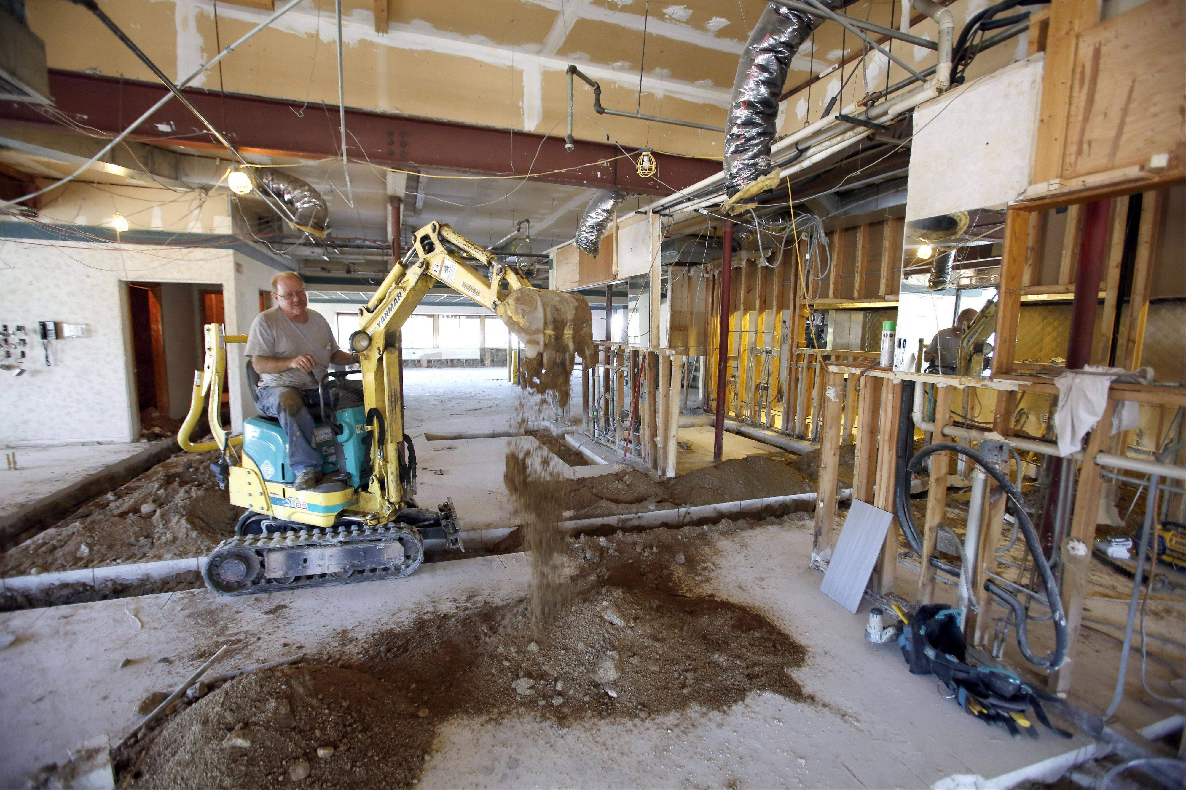 Joe Bero of Joe Bero and Son Plumbing & Piping in Elgin works on the interior of Alexander's restaurant last week. The eatery is renovating the interior and exterior, and the owners hope to be opened by December.