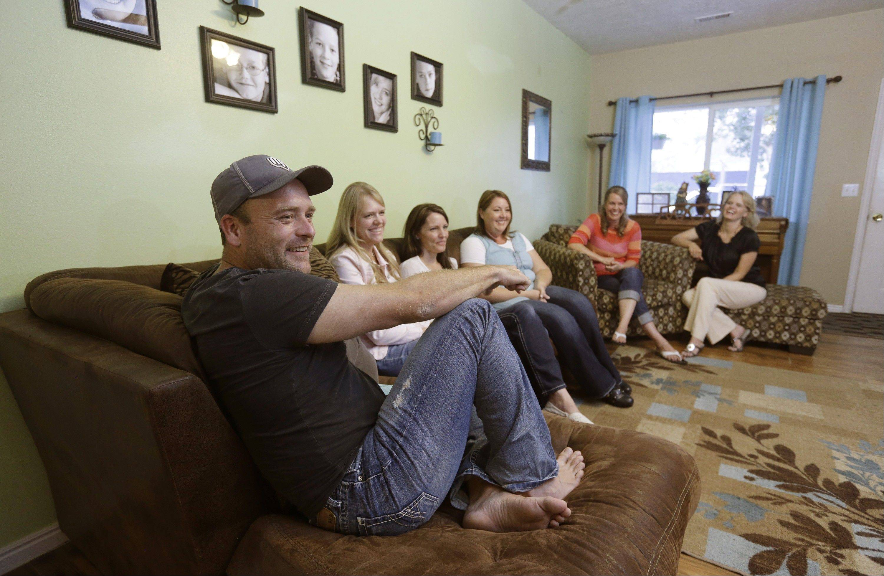 Brady Williams talks while his wives, from left, Robyn, Paulie, Rosemary, Nonie and Rhonda, look on at their home in a polygamous community outside Salt Lake City.