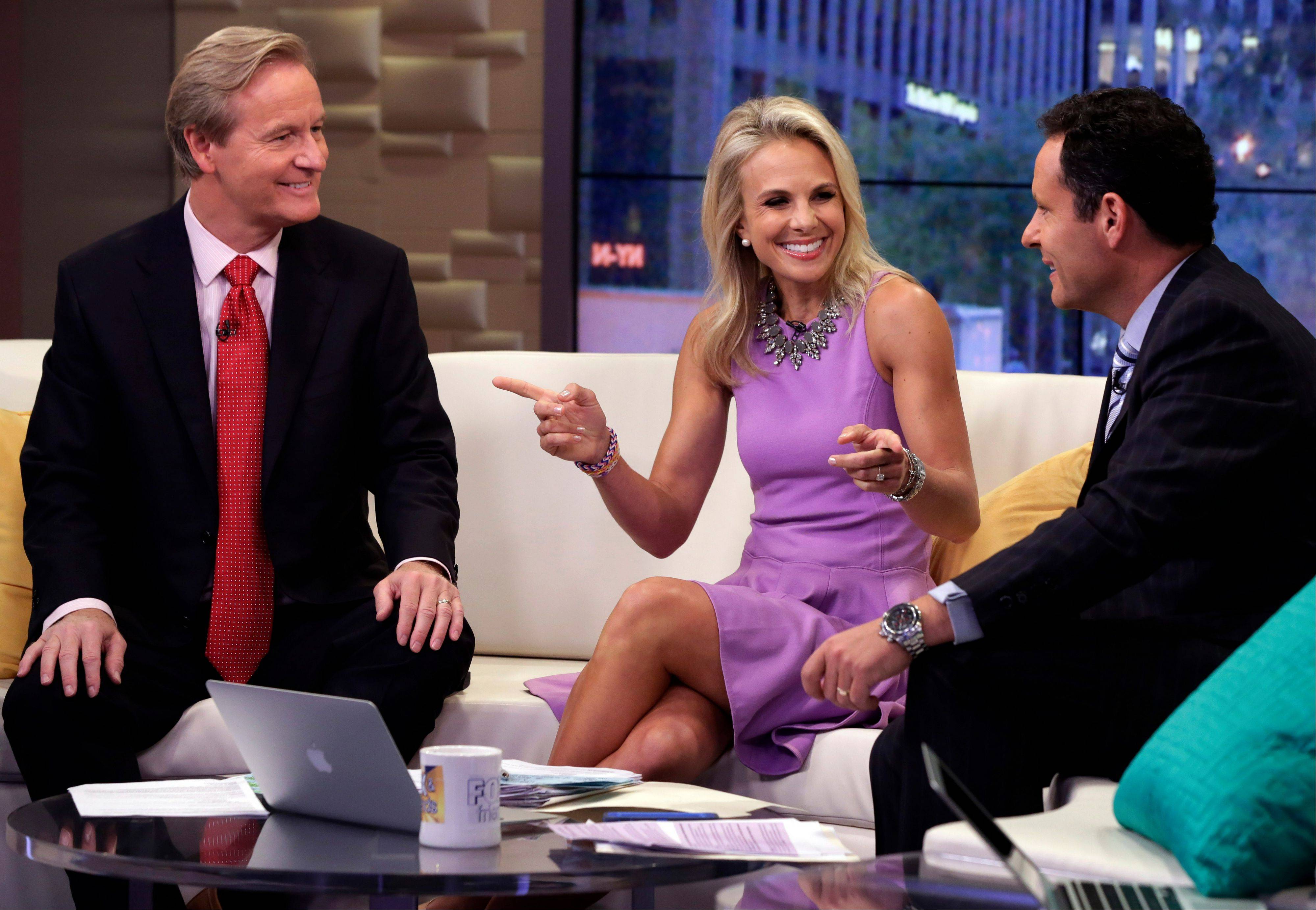 "Elisabeth Hasselbeck appears with co-hosts Steve Doocy, left, and Brian Kilmeade in her debut on the ""Fox & Friends"" television program Monday. The former cast member of ""The View"" replaced Gretchen Carlson."