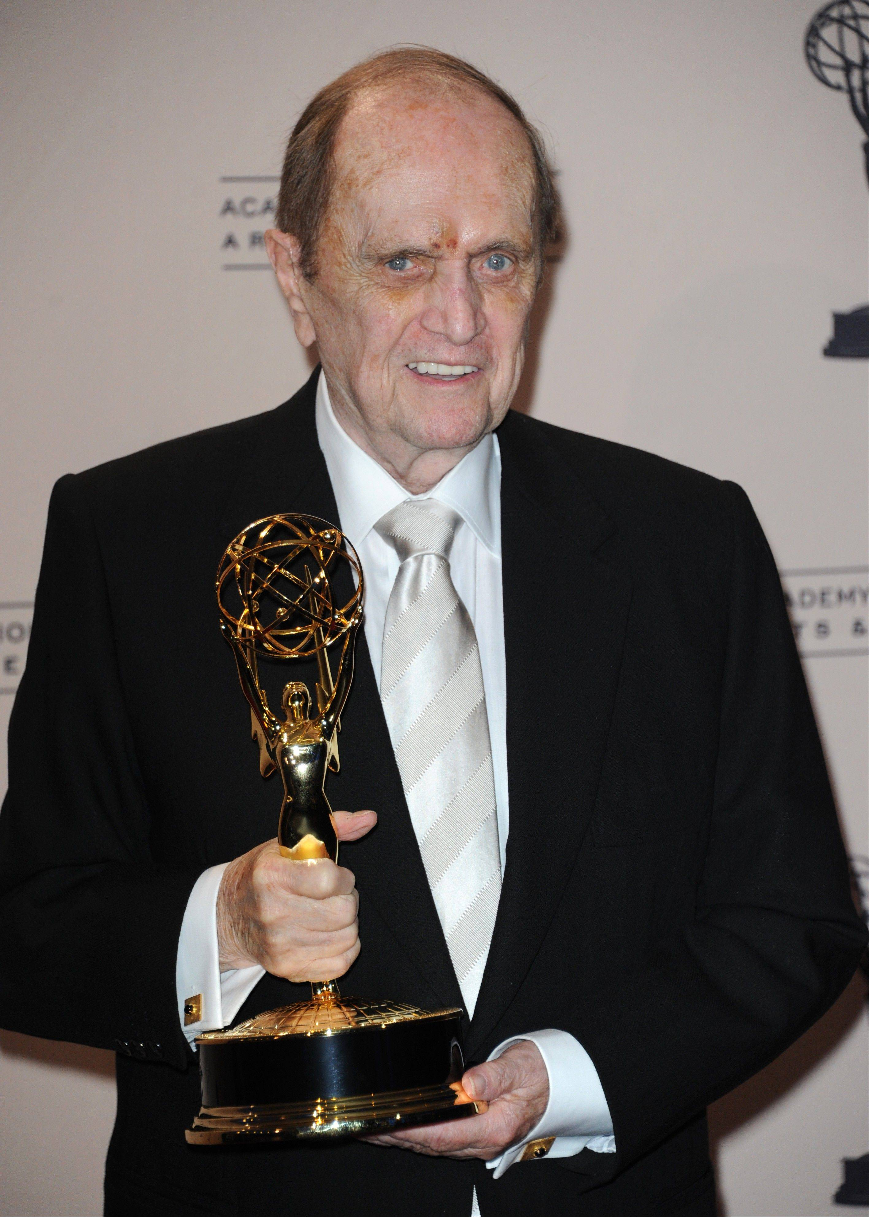 "Bob Newhart poses with his award for outstanding guest actor in a comedy series for ""The Big Bang Theory"" at the Primetime Creative Arts Emmy Awards at the Nokia Theatre on Sunday in Los Angeles."