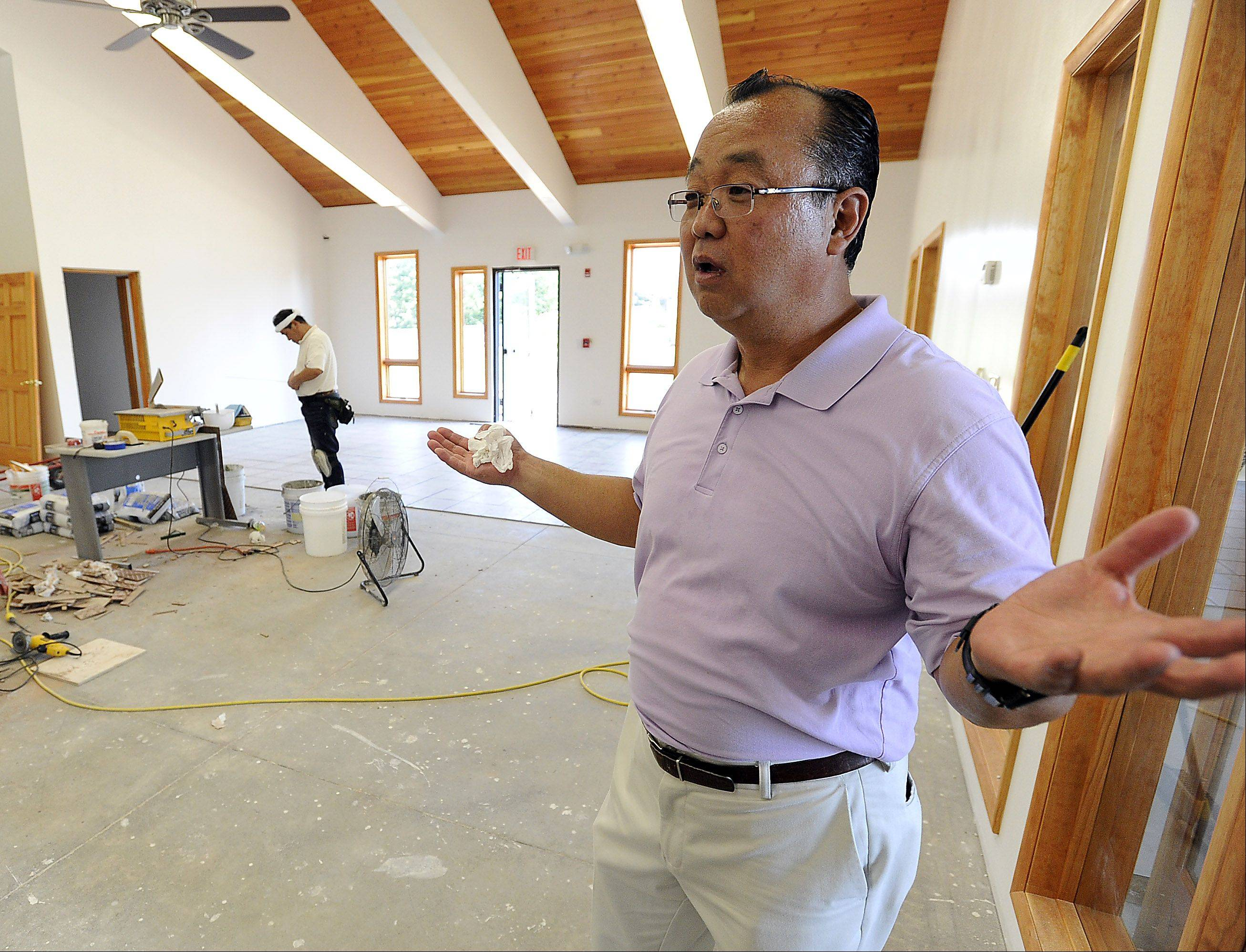 The Rev. Yugo Kobari hopes the Chicago Japanese Mission Church in Arlington Heights will be finished in time for Christmas service. Kobari said the church is about 70 percent complete thanks to volunteers from the suburbs, states as far away as Colorado and Arkansas, and even one builder from Japan.