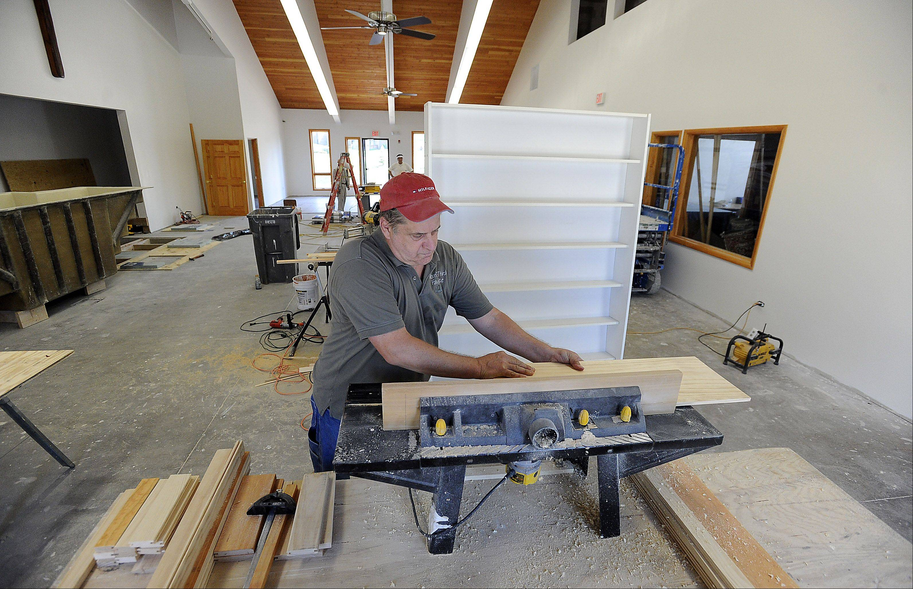 Rich Meyer of Mount Prospect works on shutters for the Chicago Japanese Mission Church in Arlington Heights. He's one of many volunteers who are bringing the church closer to finally opening late this year after a three-year effort to build it.