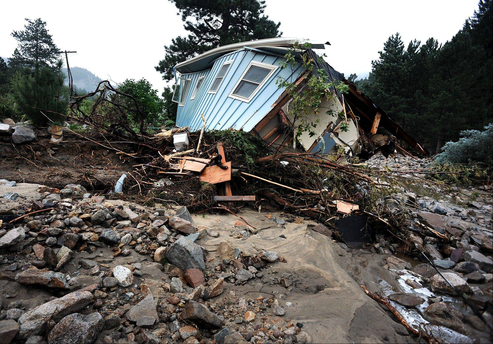A house lays completely demolished in what was the path of the recent floods that have destroyed the town of Jamestown, Colo., on Sunday. No one has been able to access the town until late Sunday afternoon when crews finalized repairs of the upper portion of the road for emergency traffic only. The town has no infrastructure or running water.