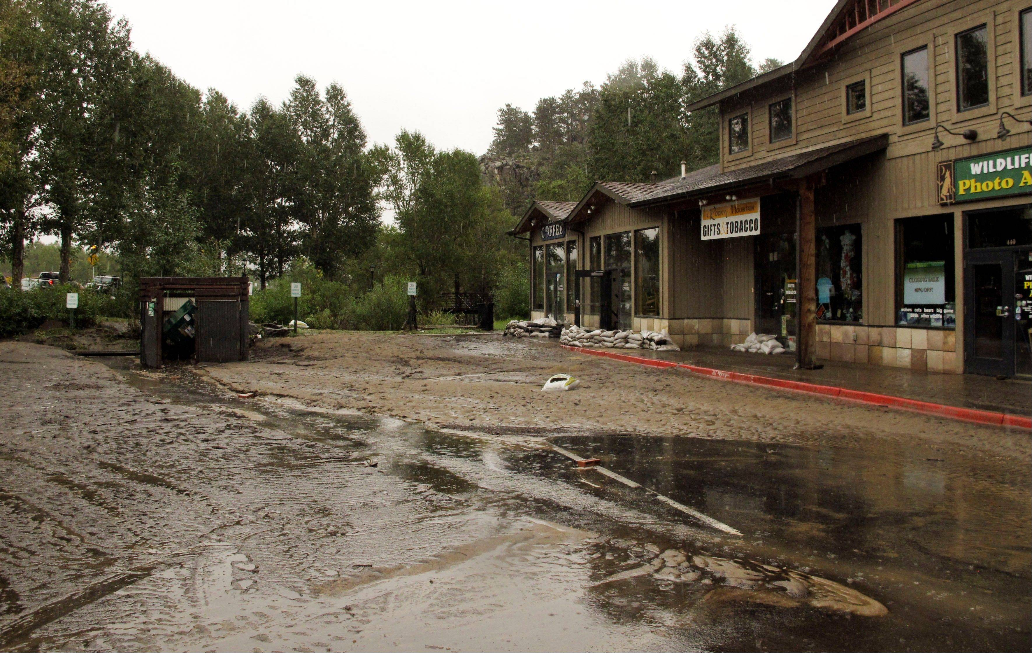 Mud from flooding is shown covering the main street in Estes Park, Colo., Sunday after water and debris swamped the town when the Big Thompson River surged through Estes Park late Thursday and early Friday.