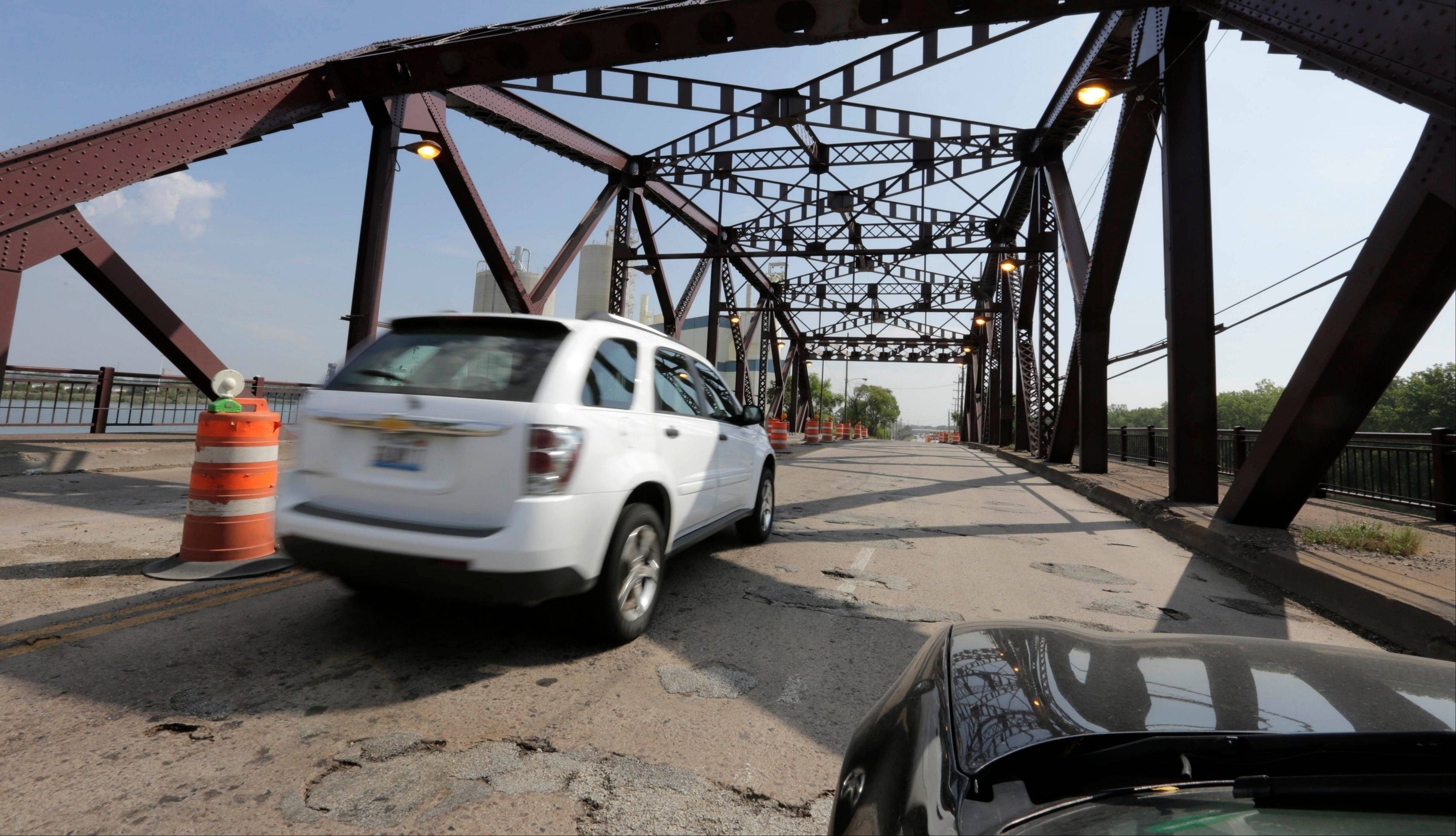 "Vehicles drive on the 130th Street bridge over the Little Calumet River in Chicago. The bridge is classified as both ""structurally deficient"" and ""fracture critical"" in the most recent federal data available for bridges in need of repair."