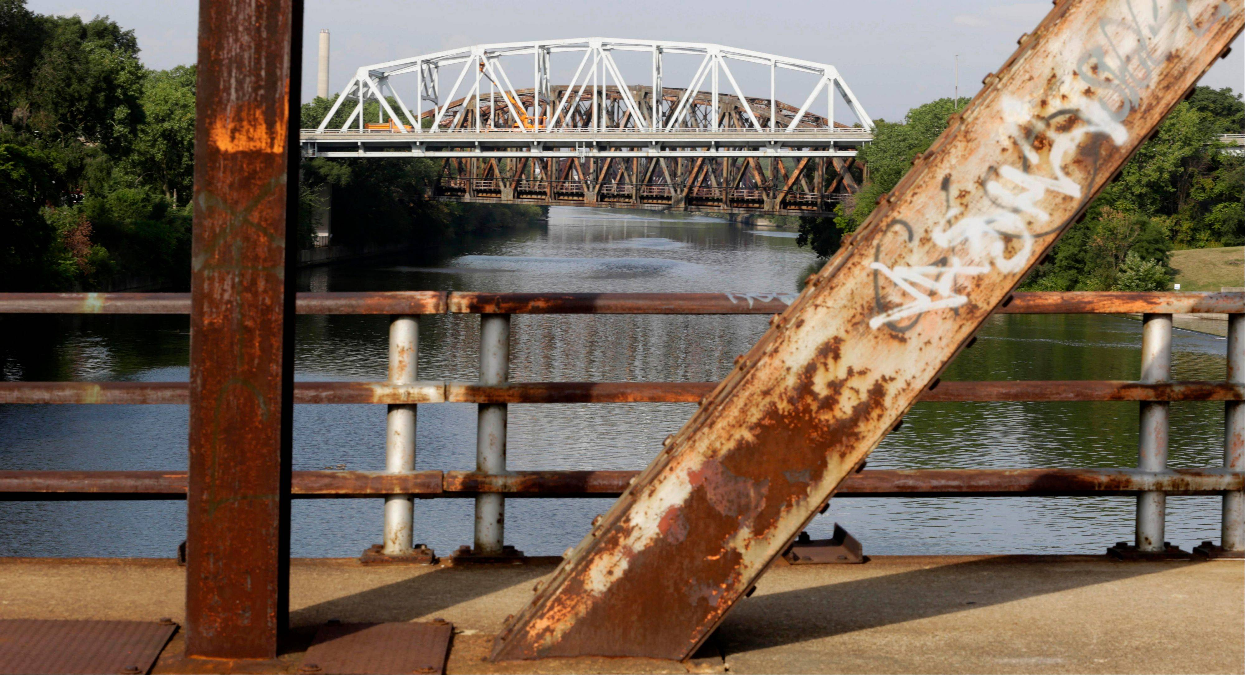The Western Avenue bridge over the Cal-Sag Channel is framed by the rusted supports of the closed Chatham Street bridge in Blue Island