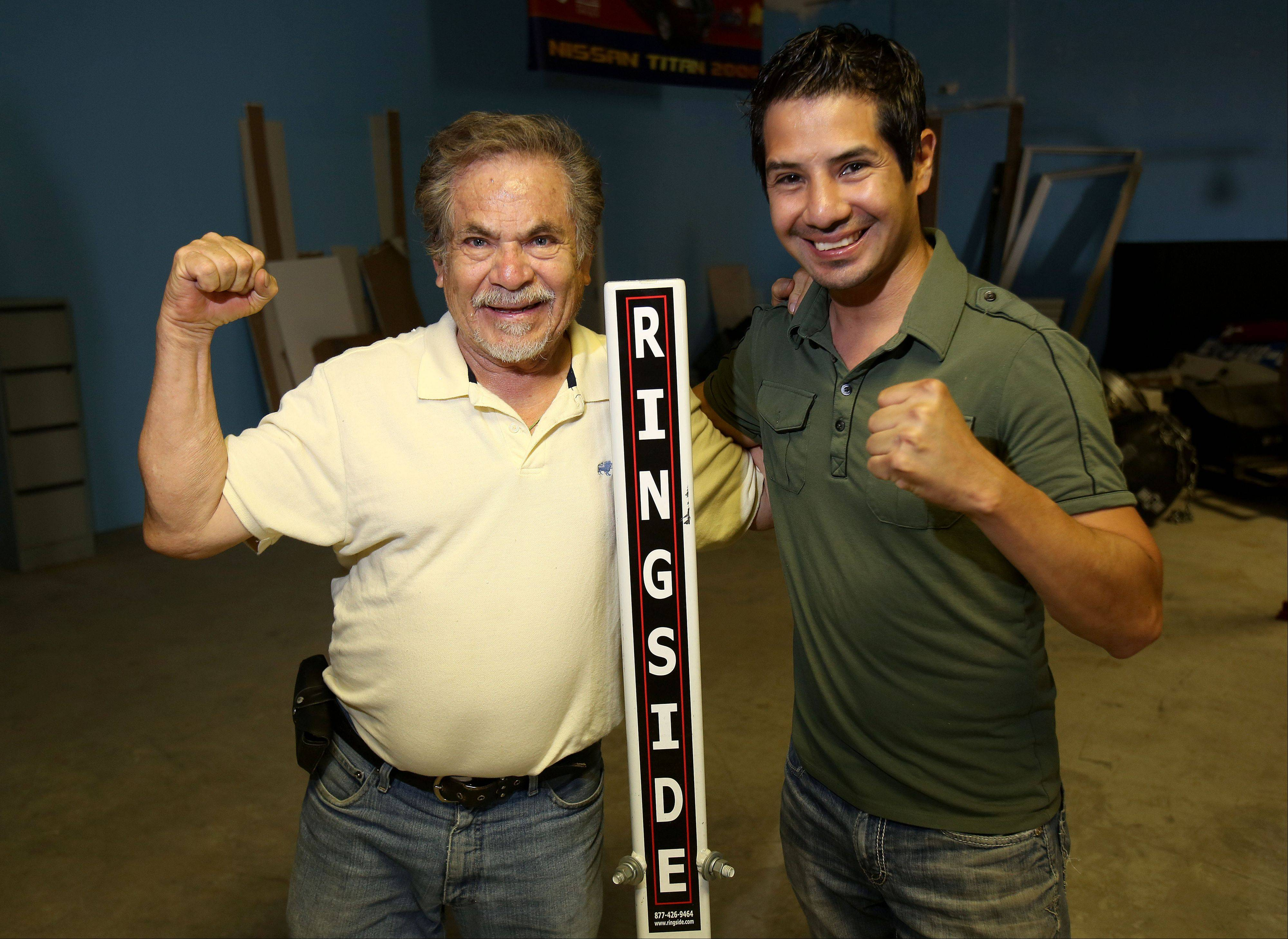 Former professional featherweight boxer Jose Hernandez, right, and his father, also Jose Hernandez, both of Round Lake, plan to open a boxing club and fitness center in Round Lake meant to serve at-risk youths.