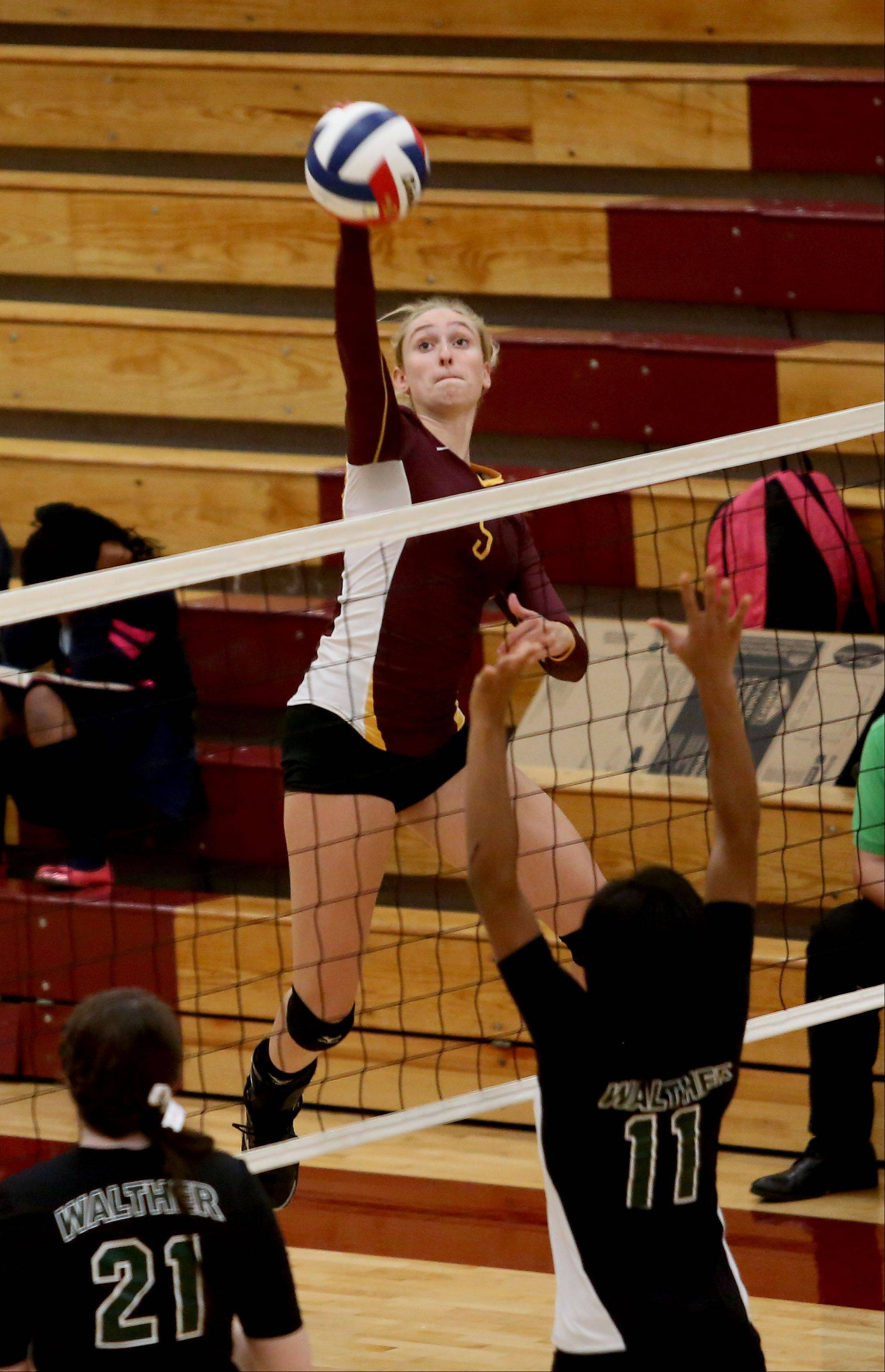 Jennifer Marten of Montini goes up to spike the ball in action against Walther Christian during girls volleyball on Monday in Lombard.