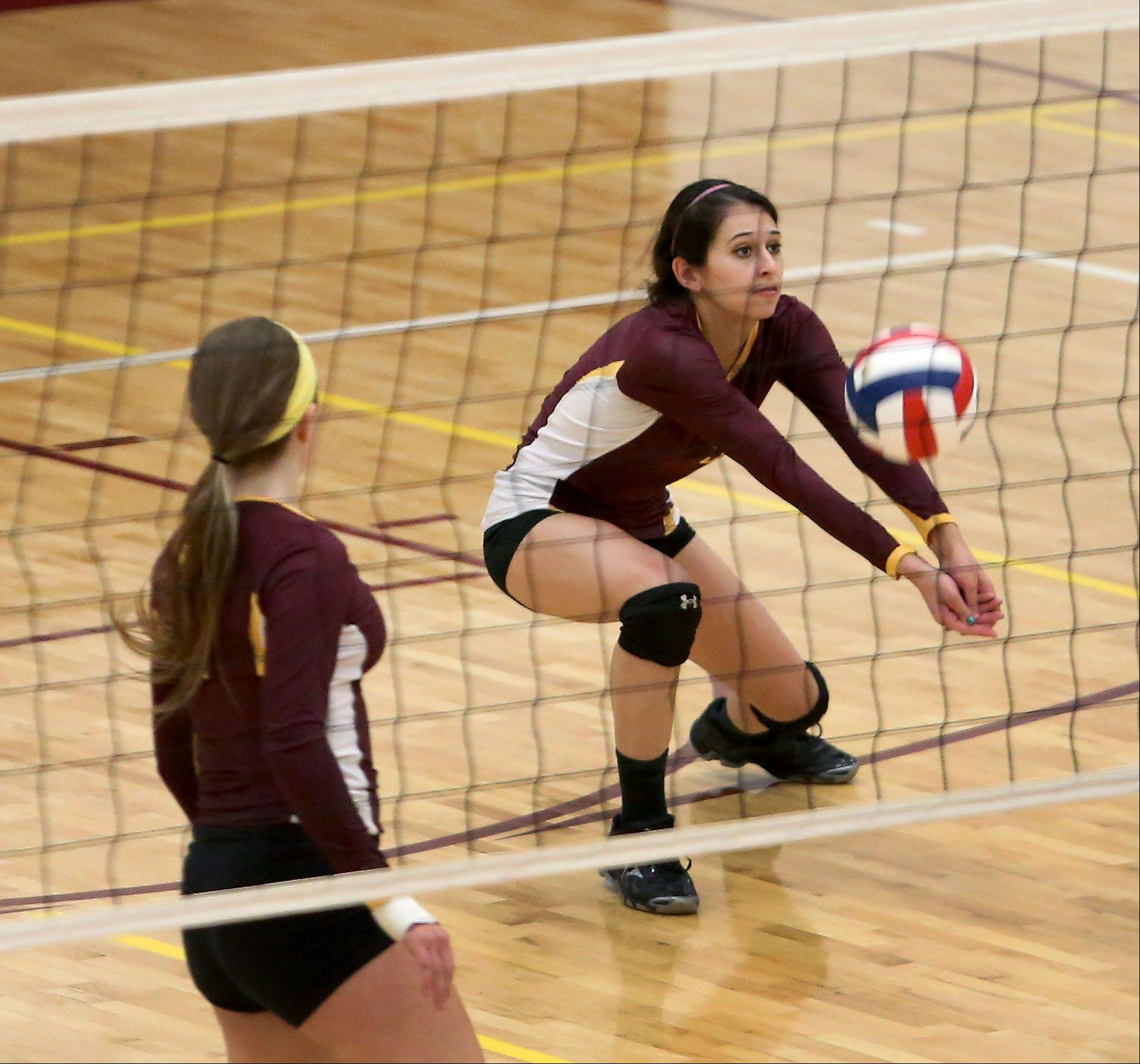 Natalie Lopez of Montini gets to the ball in action against Walther Christian during girls volleyball on Monday in Lombard.