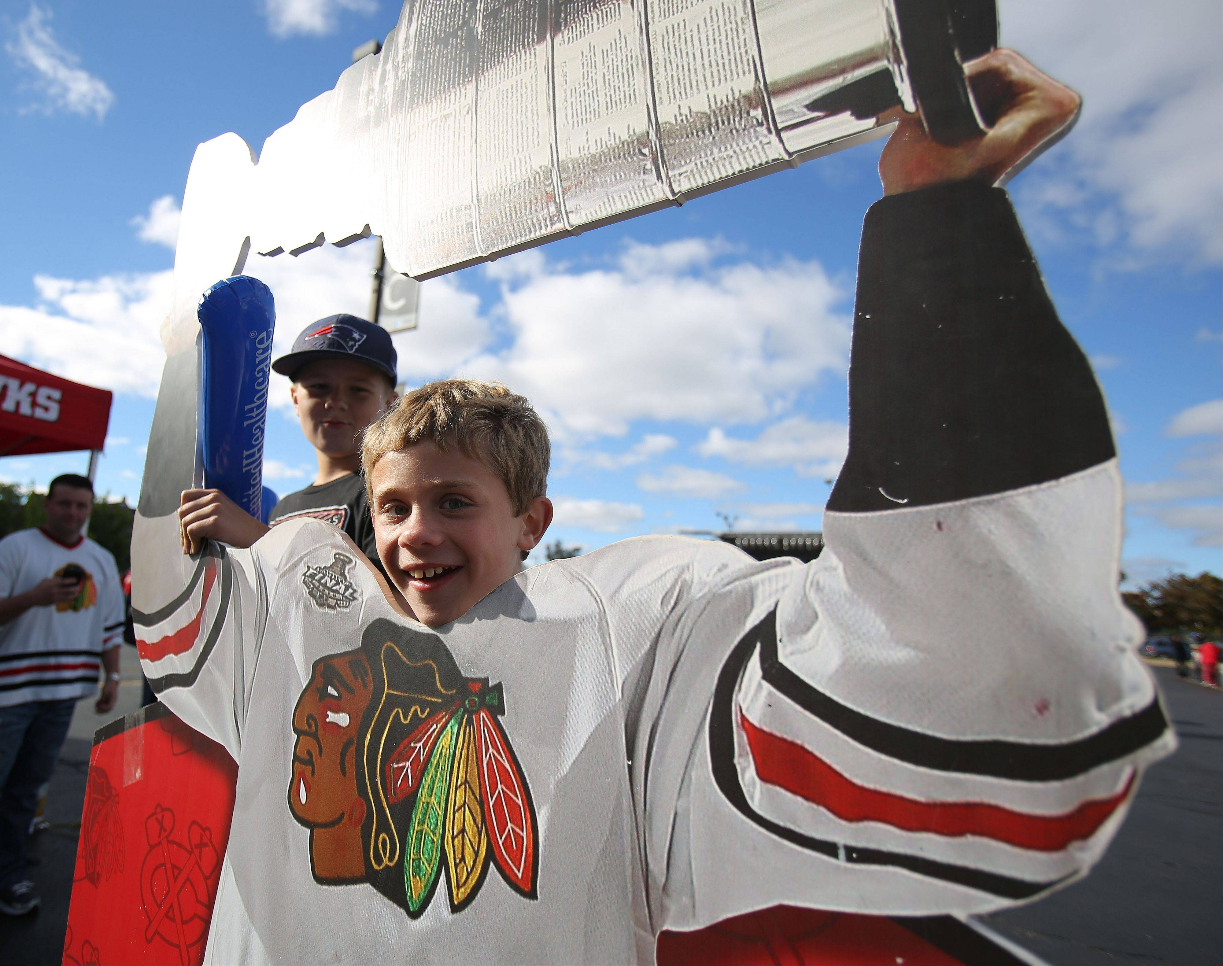 Ten-year-old Ben Scruton of Grayslake poses with a cutout of the Stanley Cup.