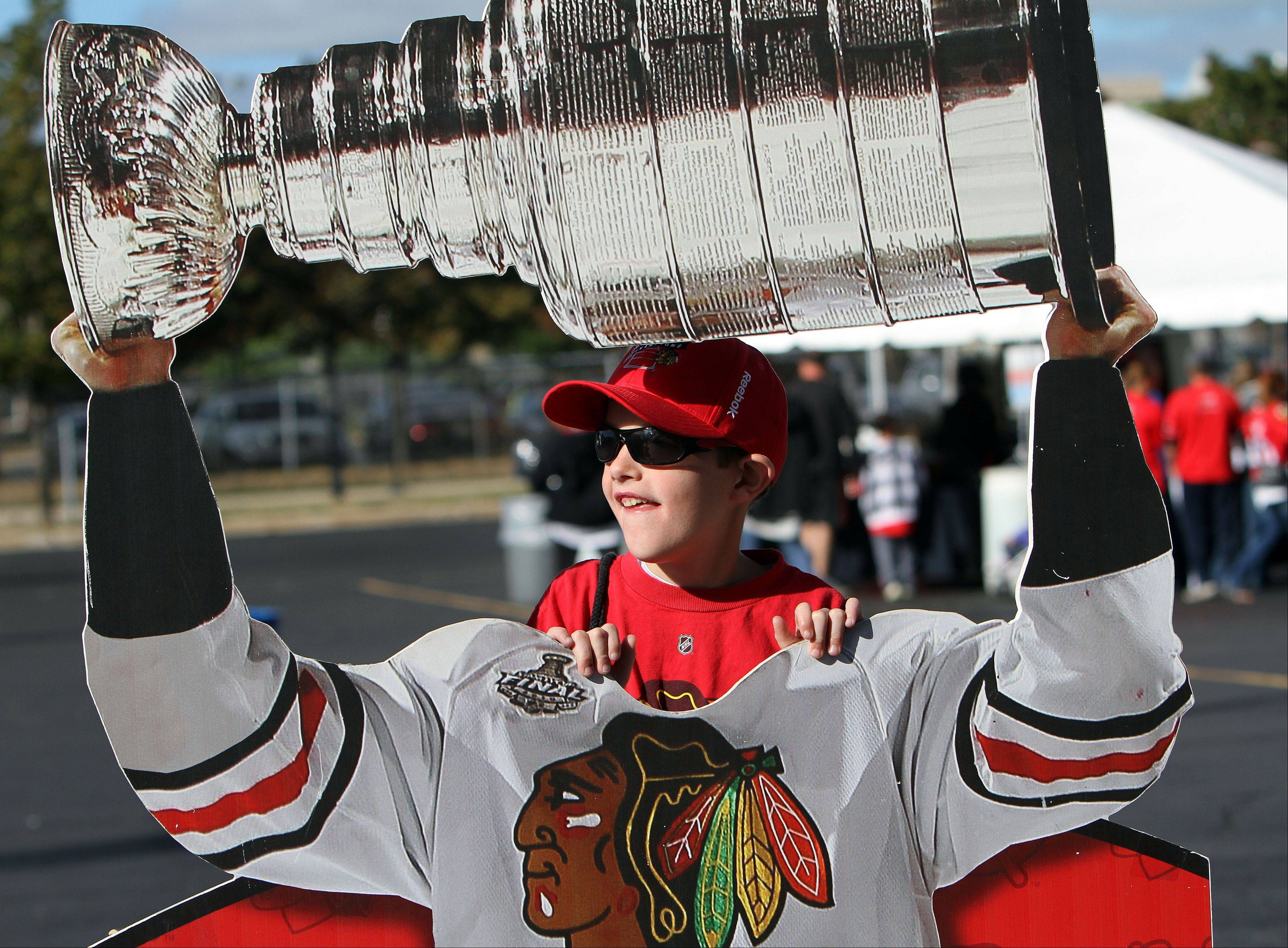 Ten-year-old Cal Hudson of Naperville poses with a cutout of the Stanley Cup.