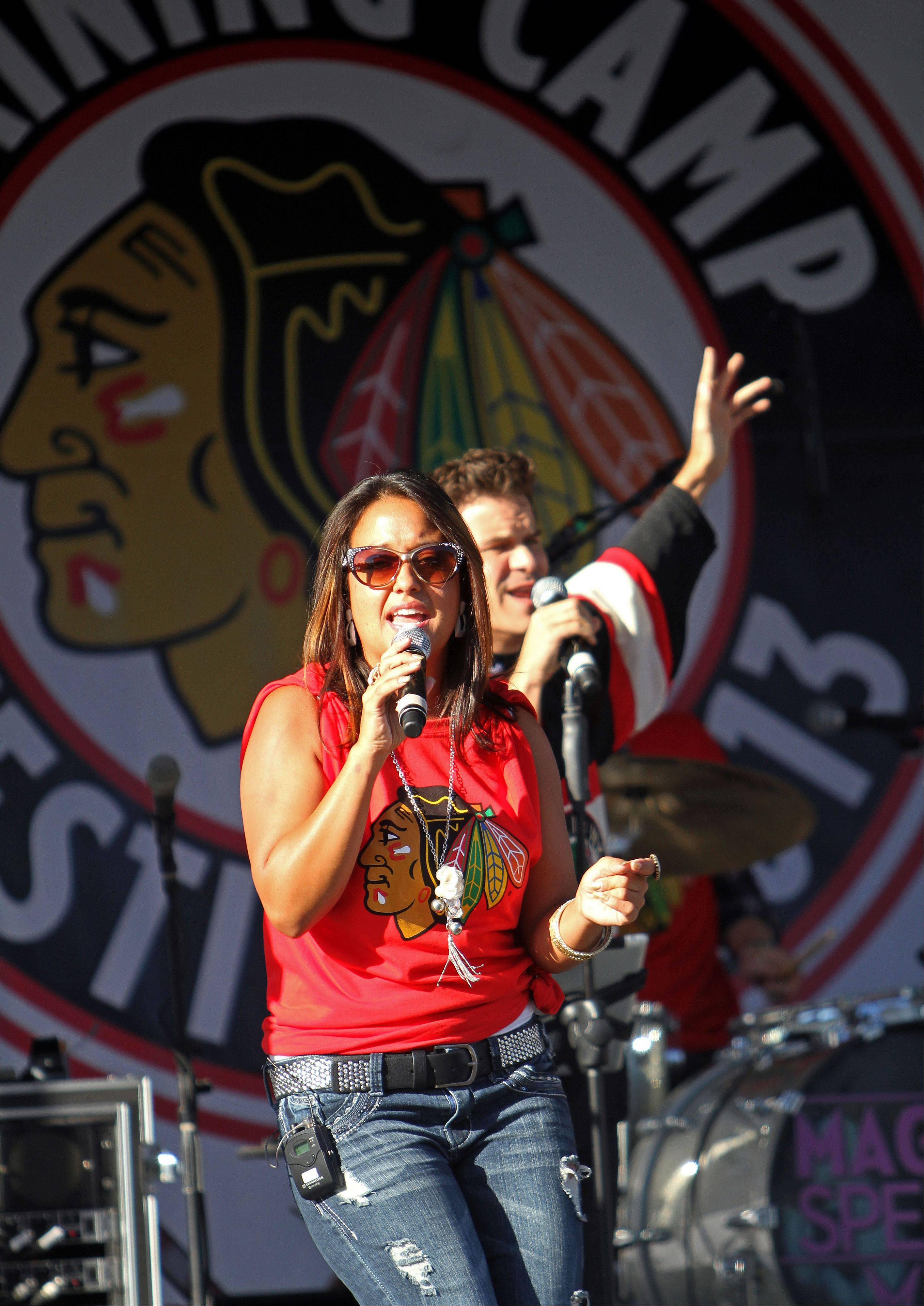 The band Maggie Speaks performs for fans in the parking lot at the United Center.