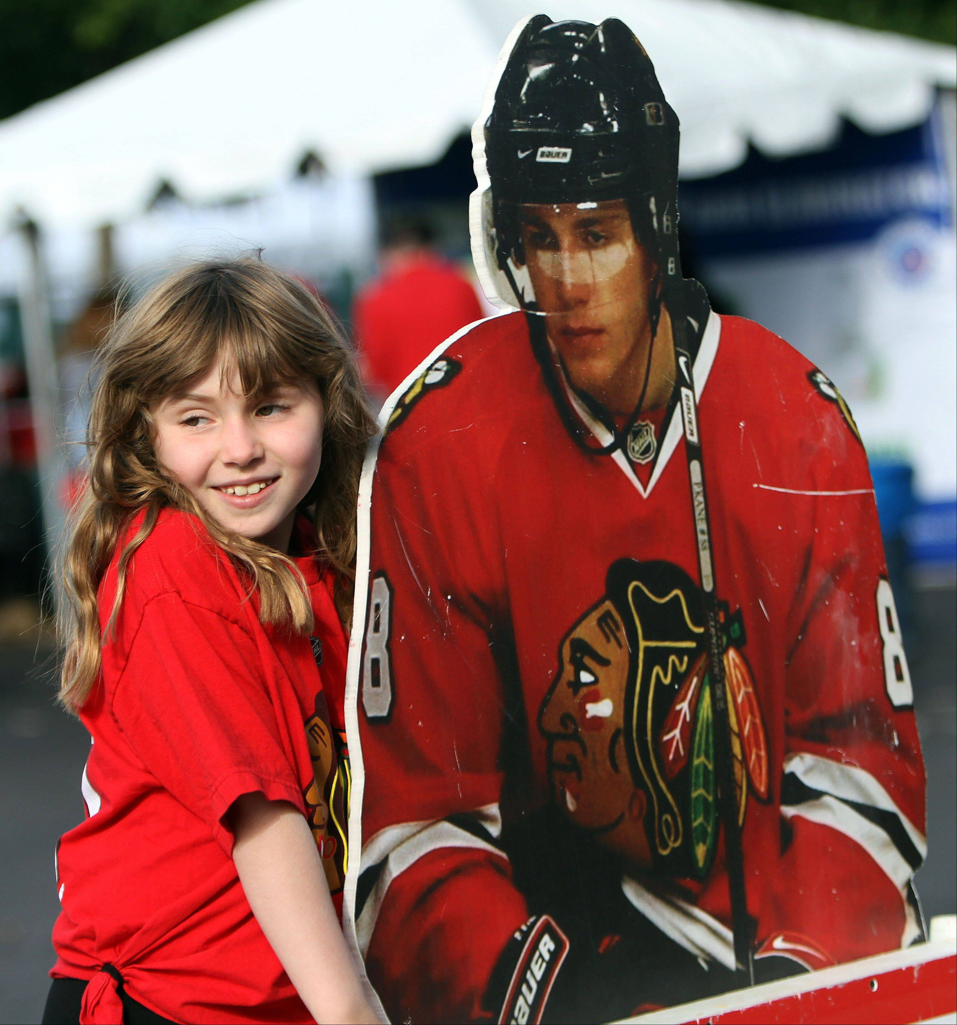Eleven-year-old Mae Olshansky of Skokie poses with a cutout of Patrick Kane.