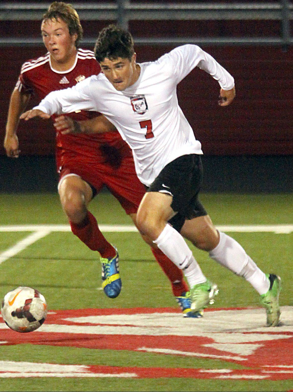 Barrington's Connor Hennelly, right, races Palatine's Gavin Falotico for control of the ball at Barrington on Monday night.