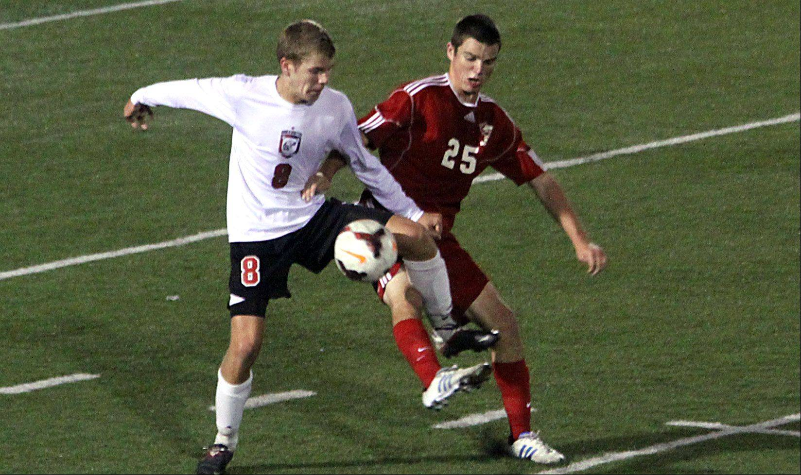 Barrington's David Conrad, left, and Palatine's Kevin Burke battle for control of the ball on Monday night at Barrington.