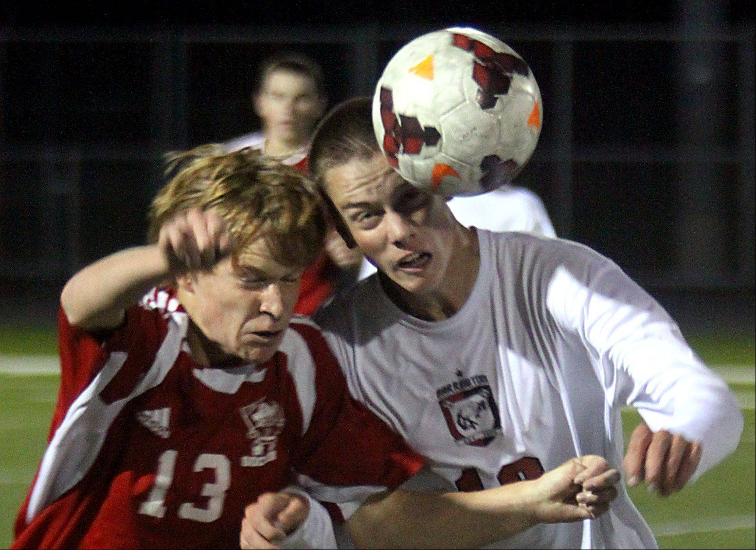Barrington's Jonathan Wilson, right, battles Palatine's Evan Braun at Barrington on Monday night.